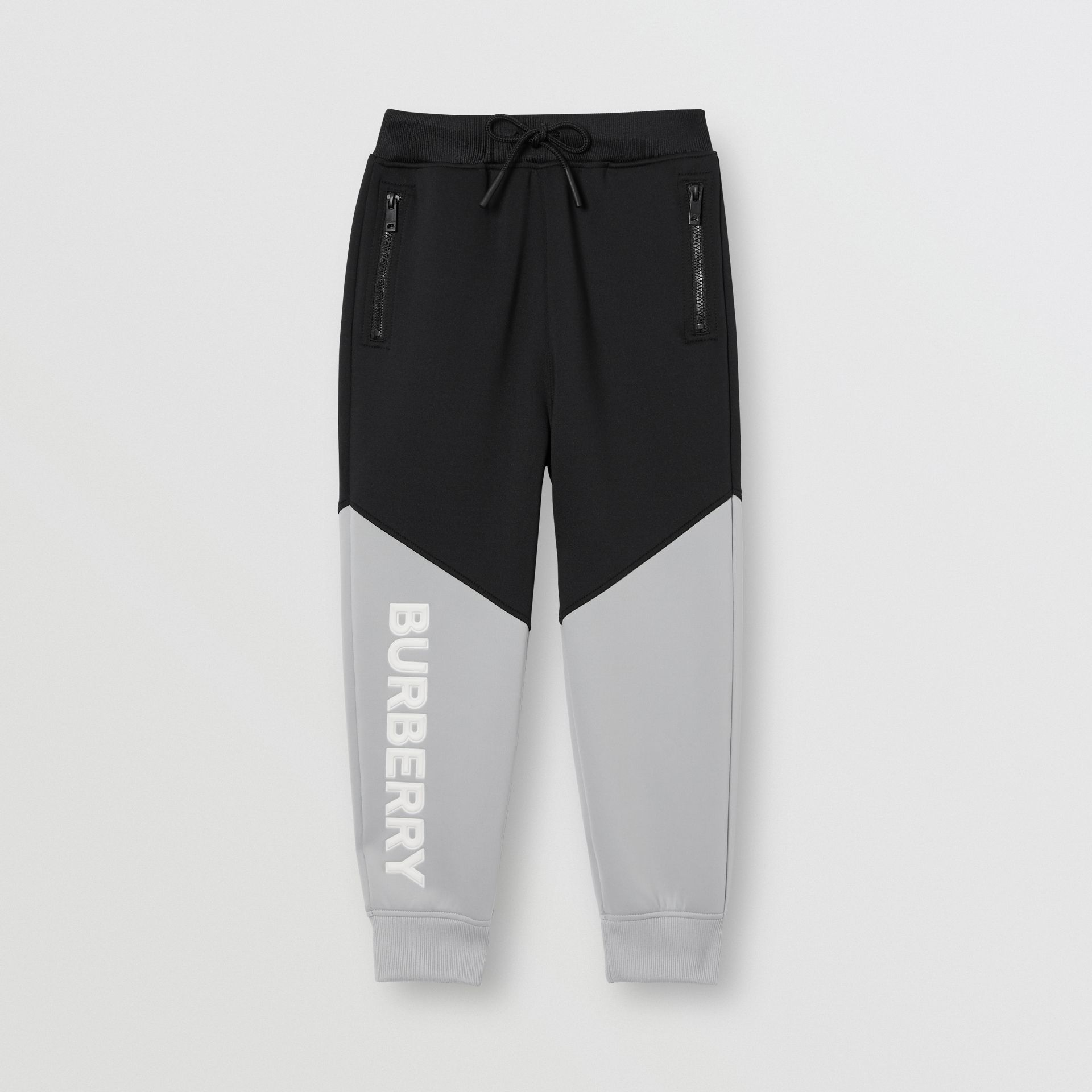 Logo Print Two-tone Stretch Jersey Trackpants in Black | Burberry - gallery image 0