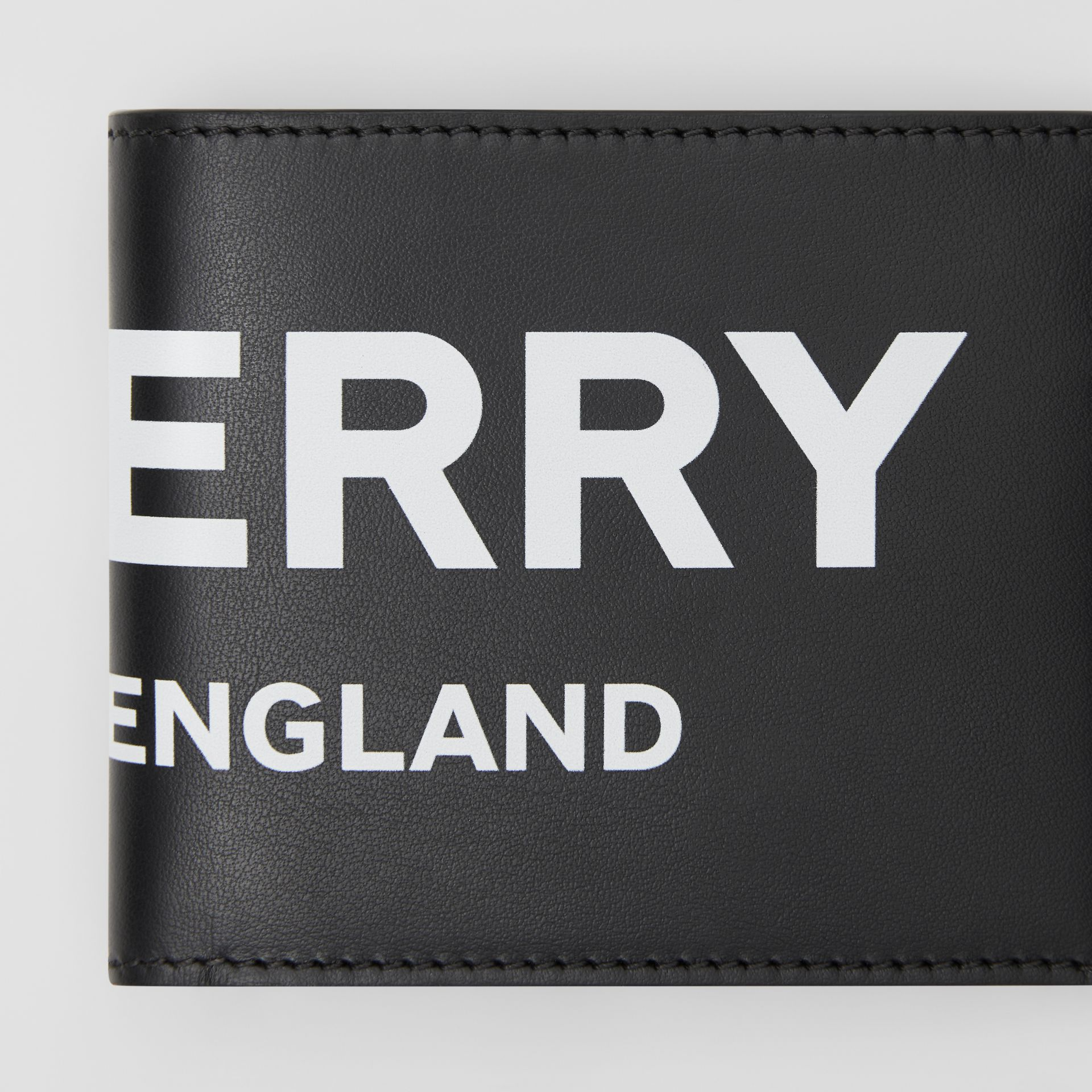 Logo Print Leather Bifold Wallet with ID Card Case in Black - Men | Burberry - gallery image 1