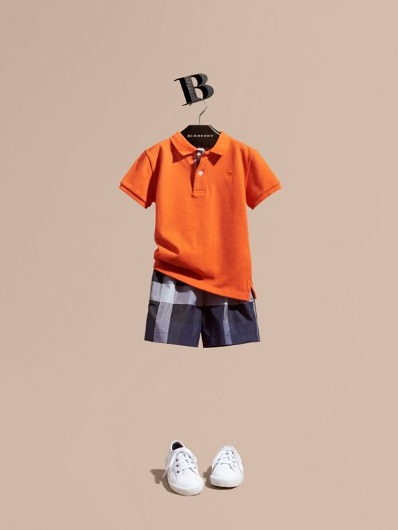 Check Placket Polo Shirt in Clementine
