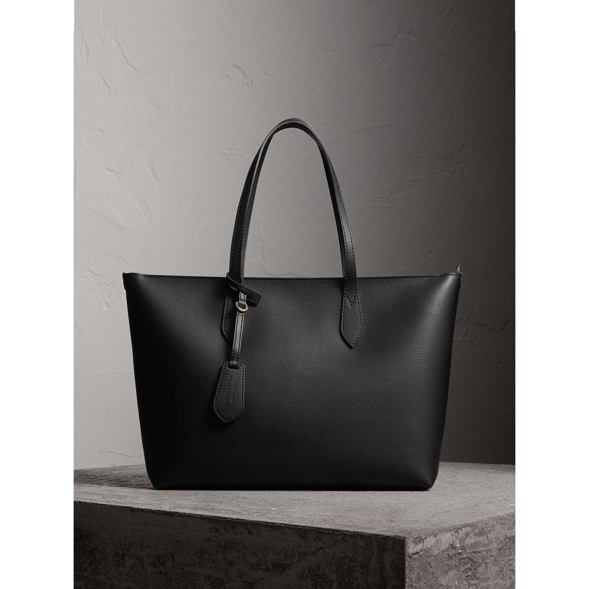 Medium Coated Leather Tote in Black - Women | Burberry United Kingdom - gallery image 1