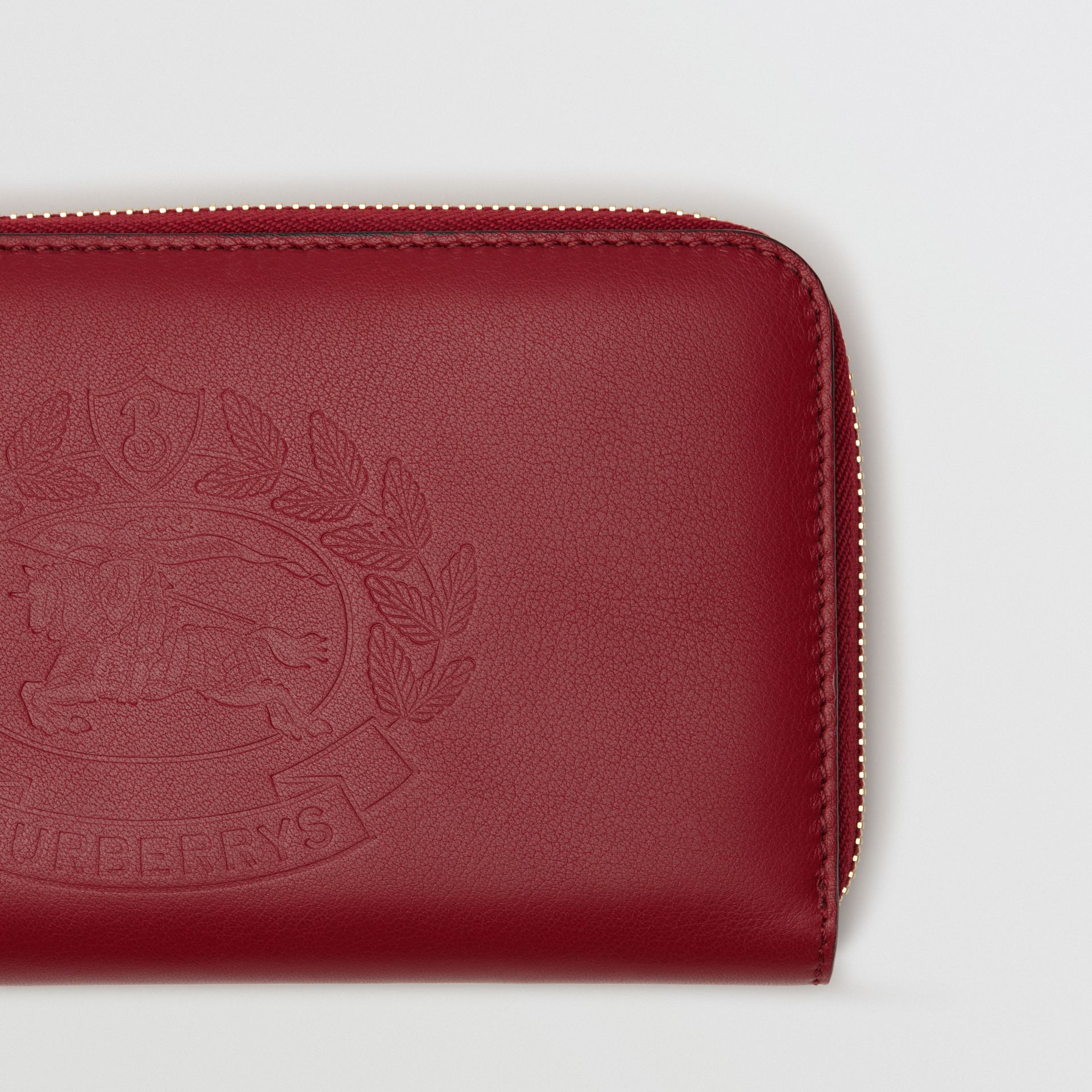 Embossed Crest Two-tone Leather Ziparound Wallet in Crimson - Women | Burberry Canada - gallery image 1