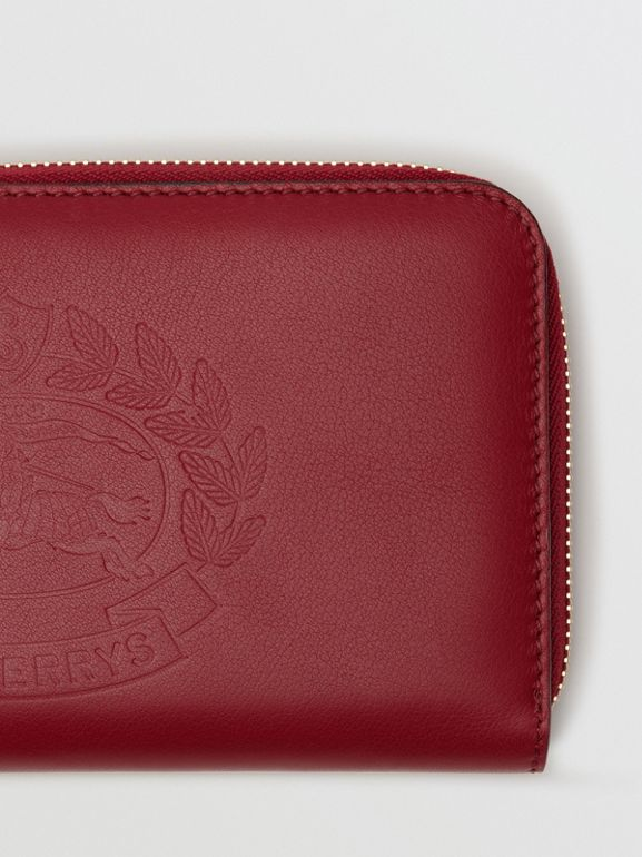 Embossed Crest Two-tone Leather Ziparound Wallet in Crimson - Women | Burberry Canada - cell image 1