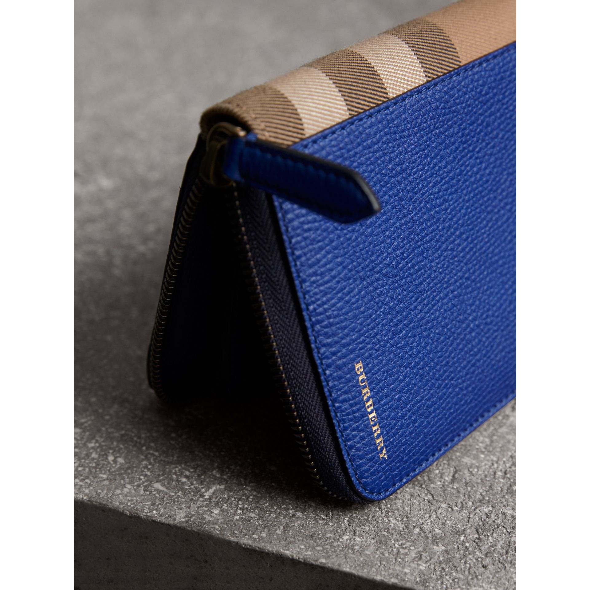 House Check and Grainy Leather Ziparound Wallet in Deep Blue | Burberry - gallery image 1