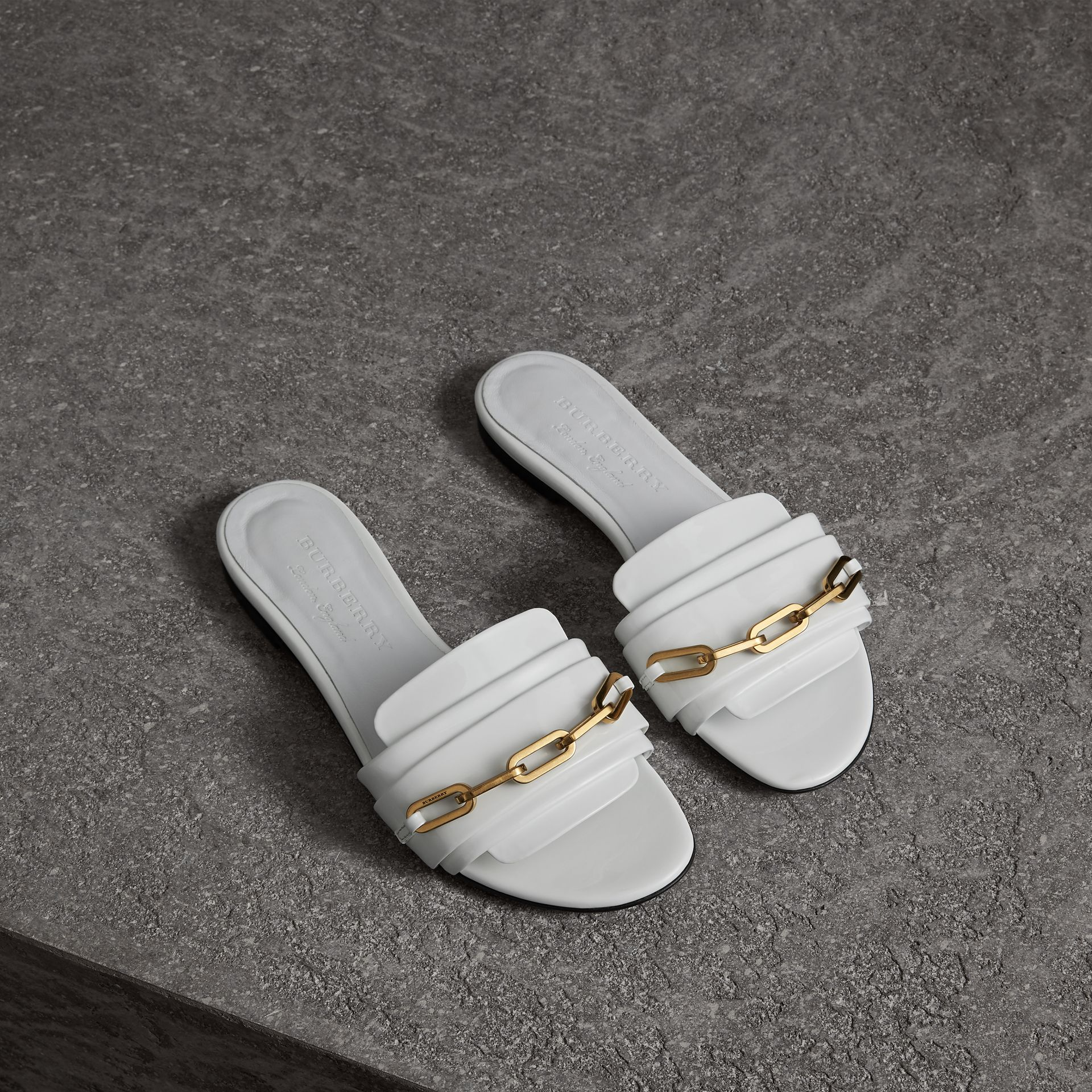 Link Detail Patent Leather Slides in Optic White - Women | Burberry Canada - gallery image 0