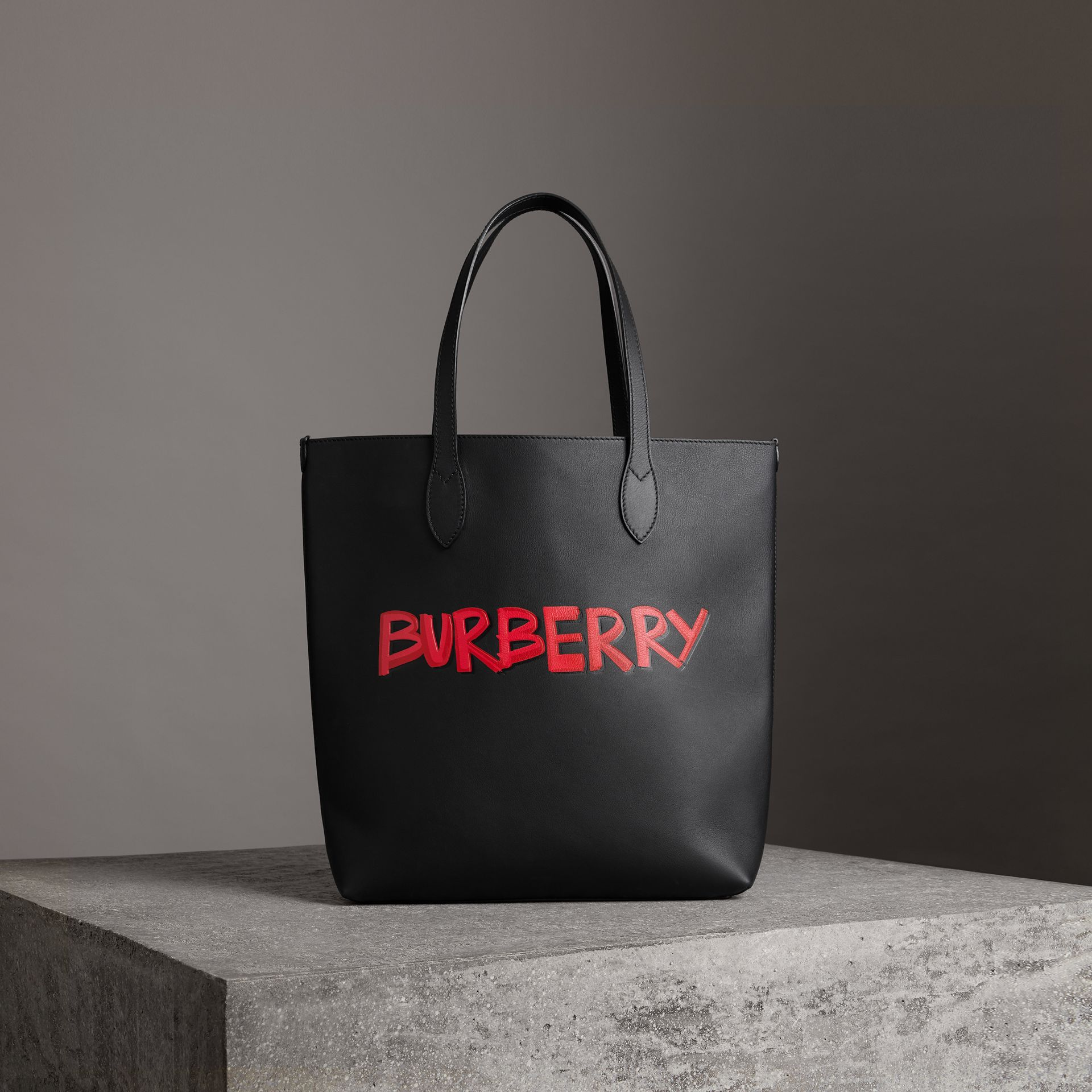 Graffiti Print Bonded Leather Tote in Black | Burberry - gallery image 0