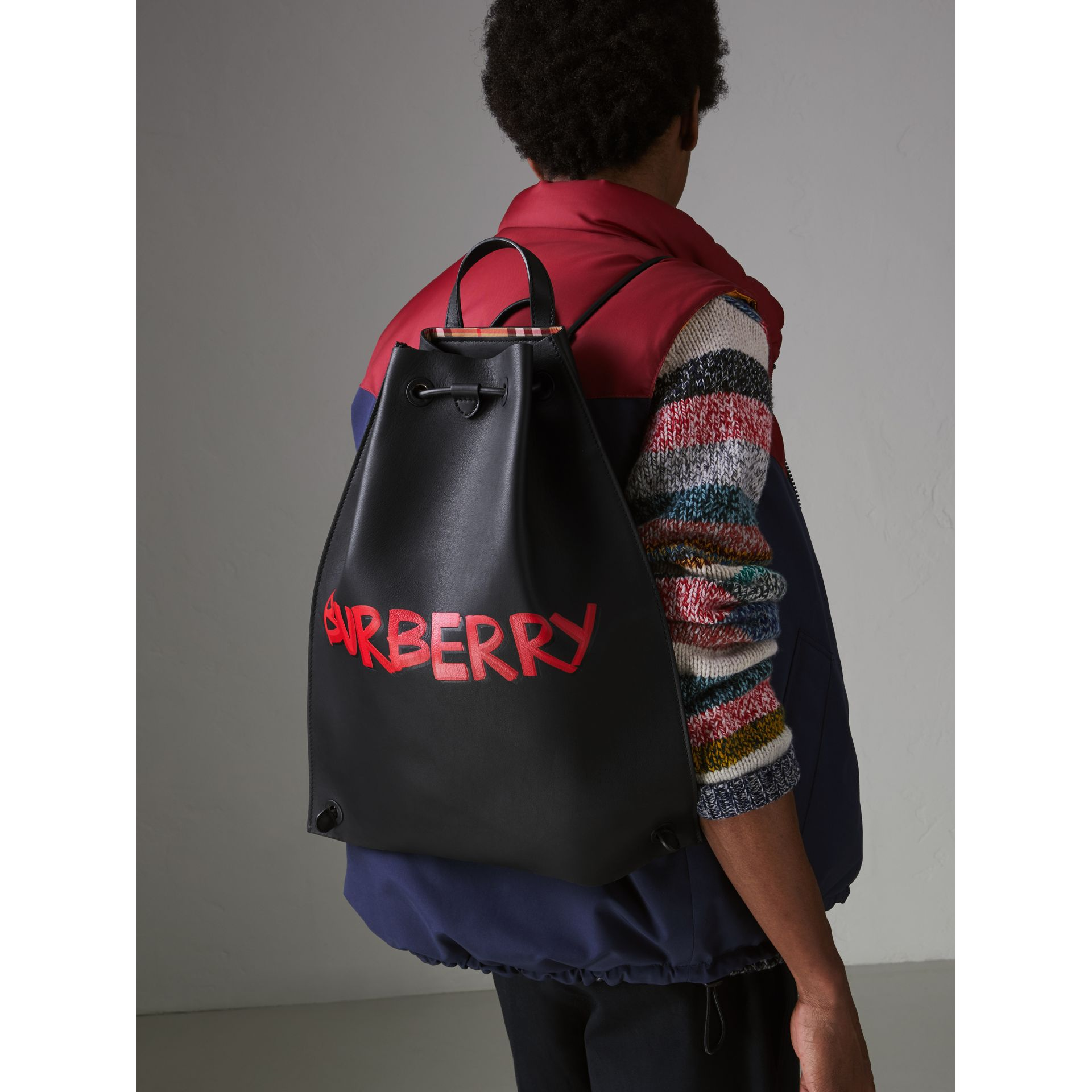Graffiti Print Bonded Leather Drawcord Backpack in Black - Men | Burberry - gallery image 3