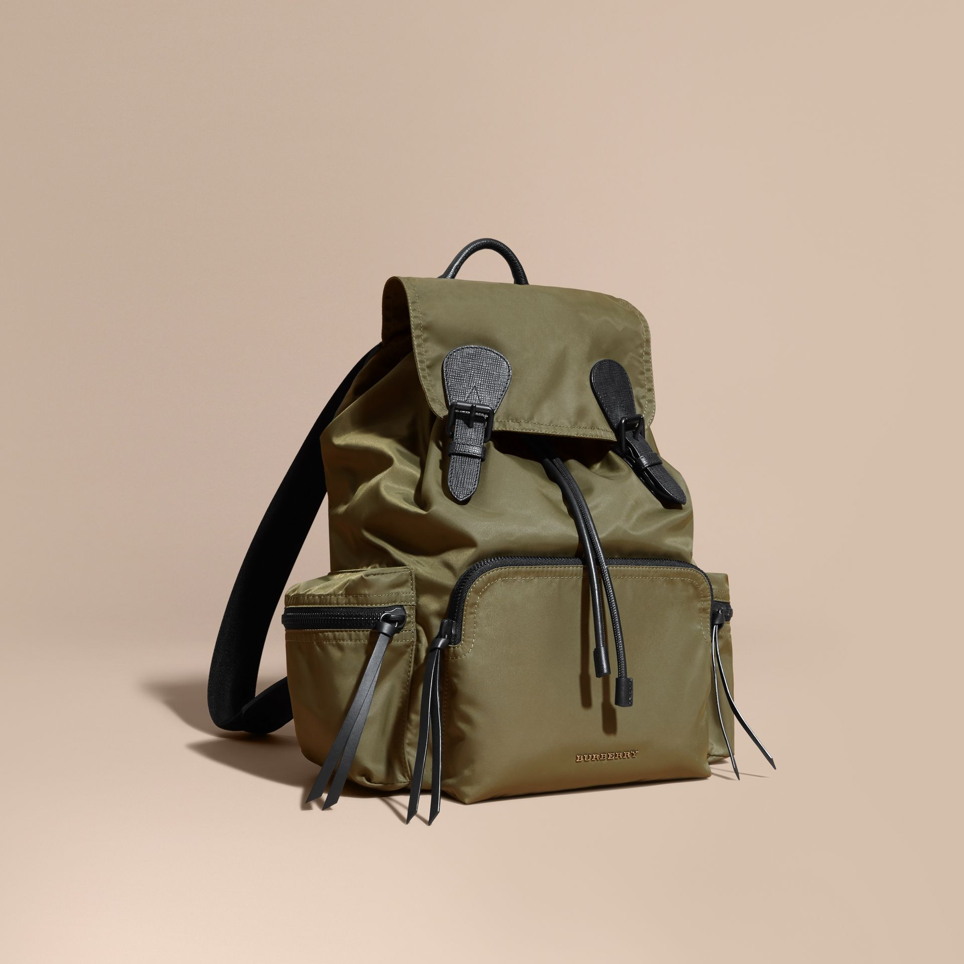 The Large Rucksack in Technical Nylon and Leather Canvas Green - gallery image 1