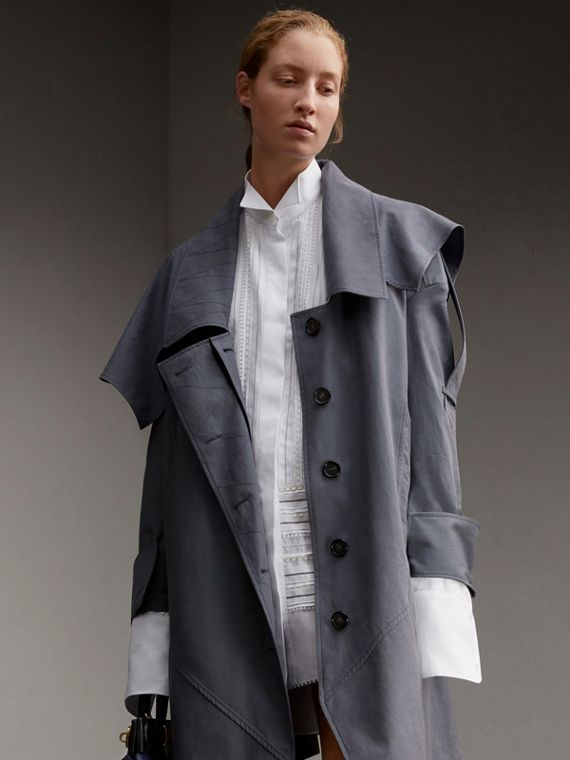 Trench-coat asymétrique en gabardine tropicale