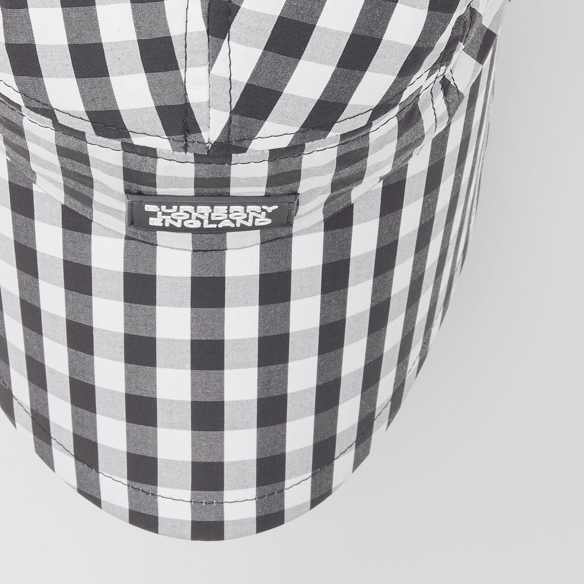 Logo Appliqué Gingham Cotton Bonnet Cap in Black/white | Burberry - gallery image 1