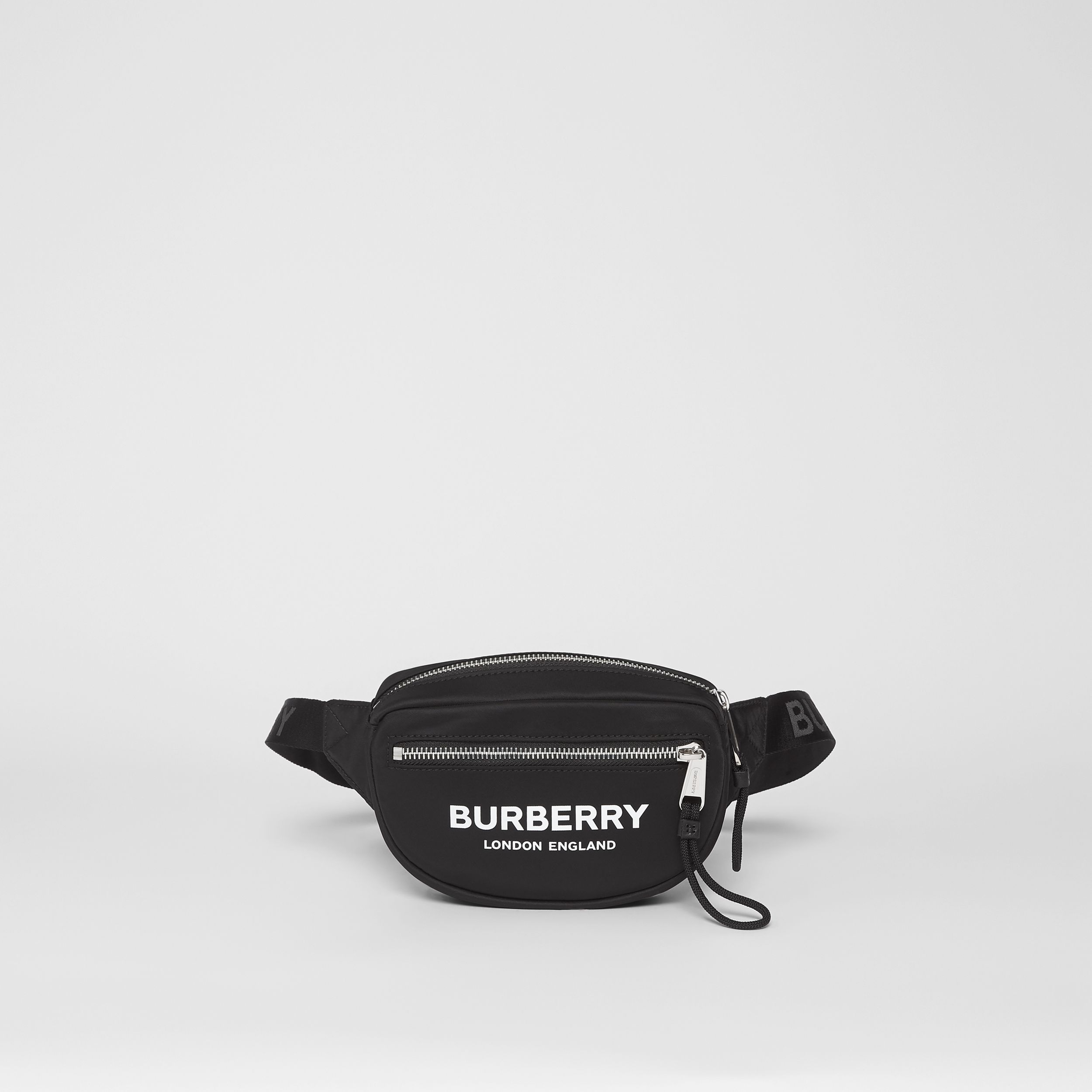 Small Logo Print ECONYL® Cannon Bum Bag in Black | Burberry United Kingdom - 1