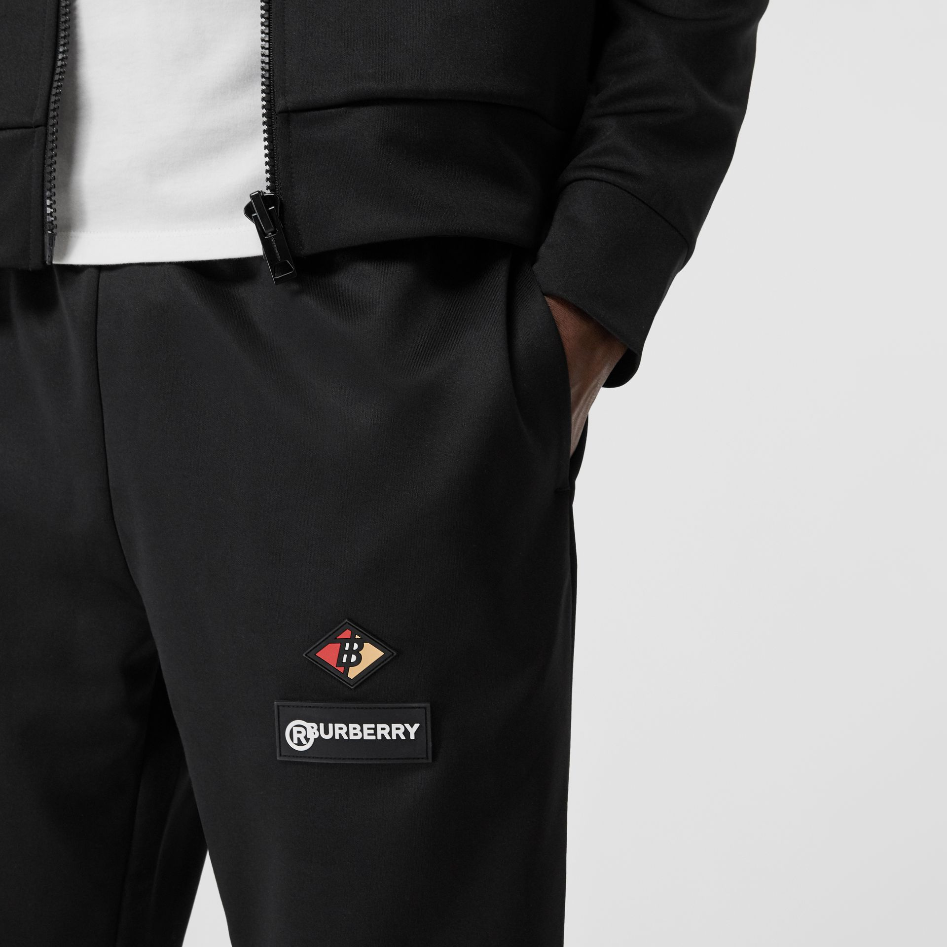 Logo Graphic Jersey Trackpants in Black - Men | Burberry Hong Kong S.A.R - gallery image 1