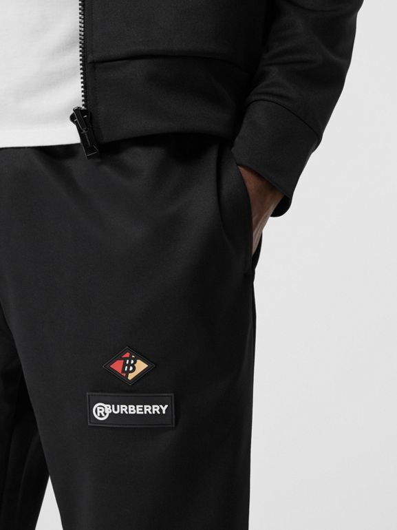 Logo Graphic Jersey Trackpants in Black - Men | Burberry Hong Kong S.A.R - cell image 1