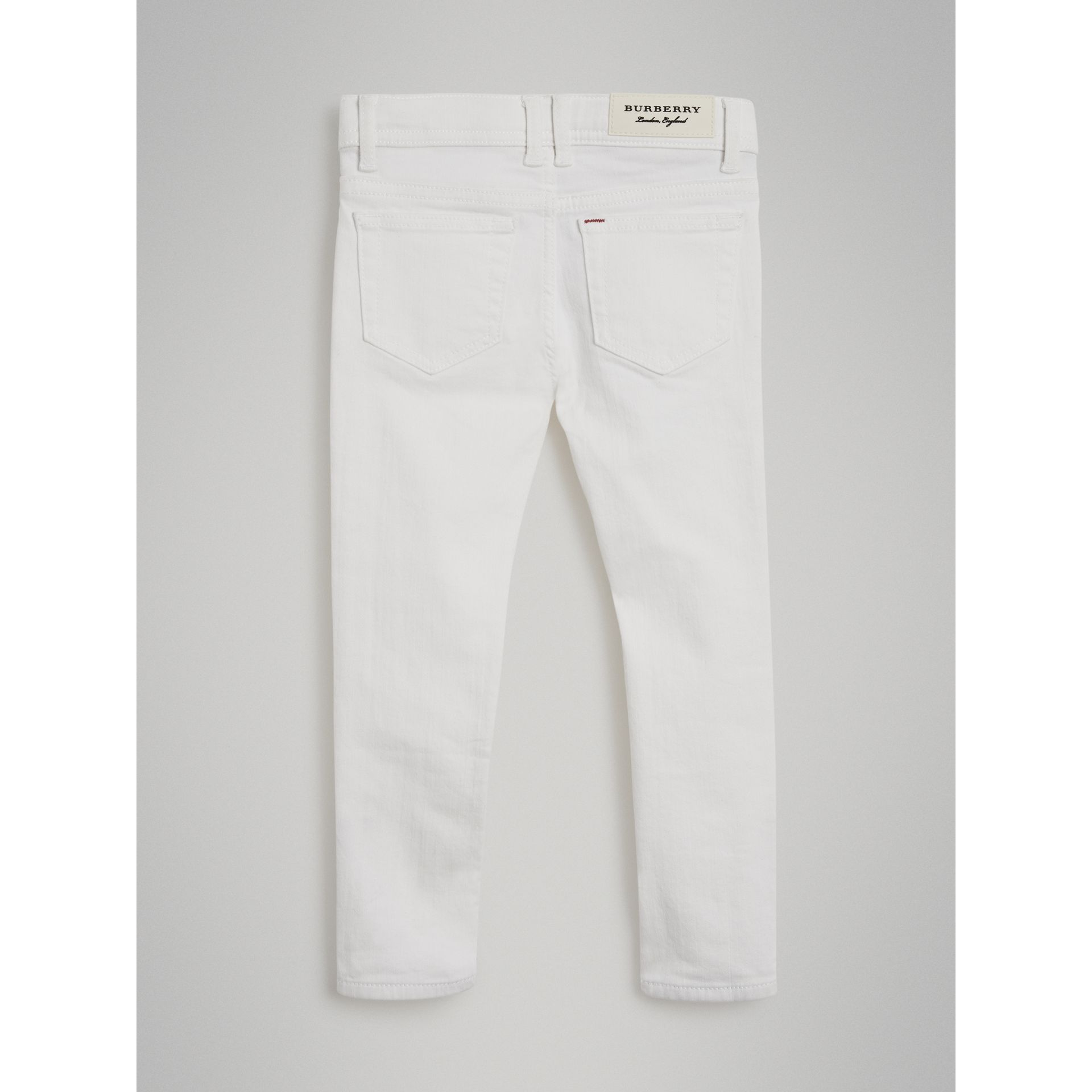Skinny Fit Stretch Jeans in White - Girl | Burberry - gallery image 3