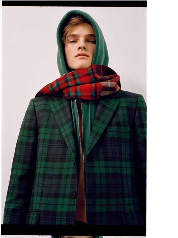 Hugo pulls his look together with a patchwork of tartan and check.