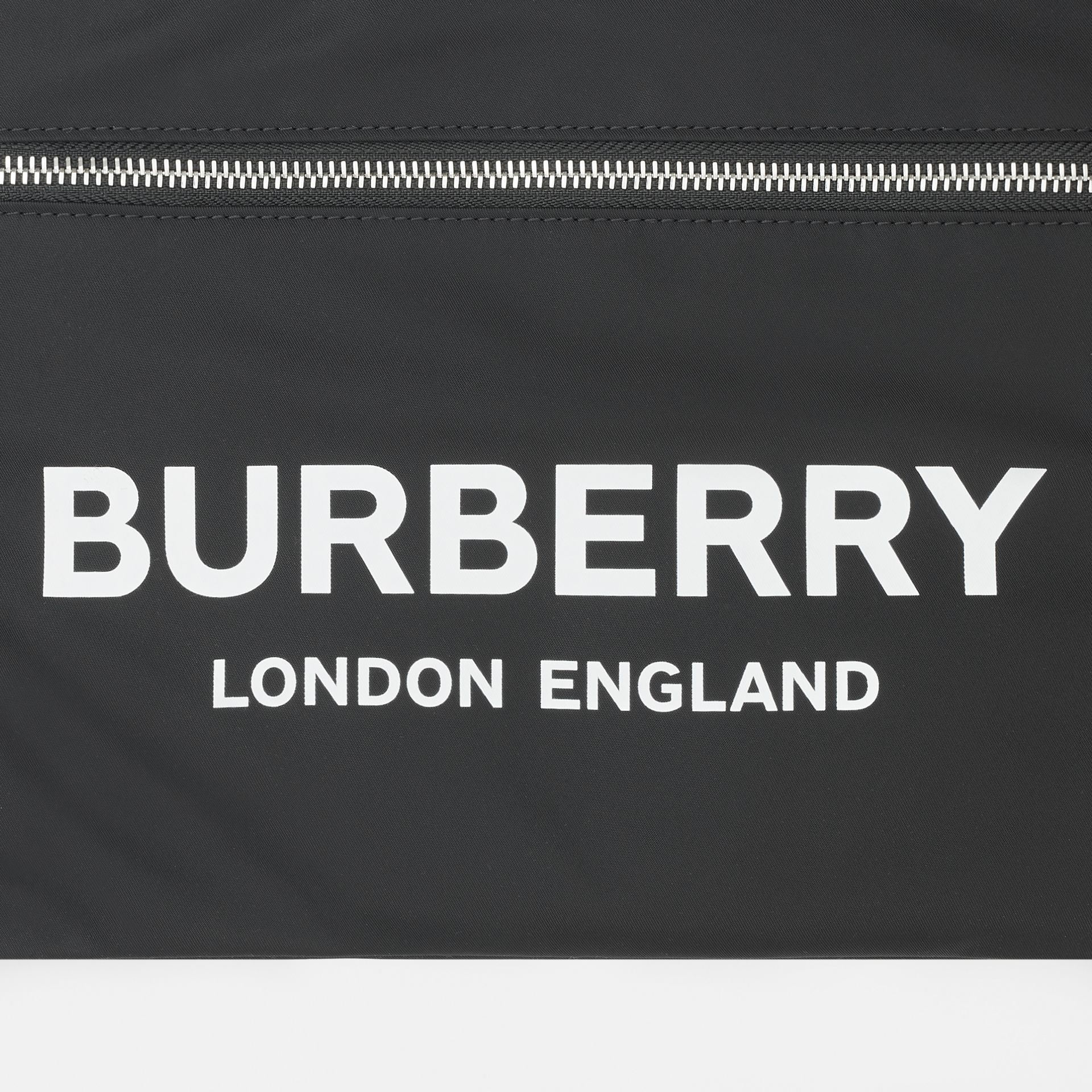 Logo Print ECONYL® Portrait Pouch in Black | Burberry - gallery image 1