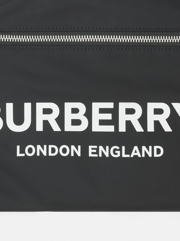 Logo Print ECONYL® Portrait Pouch in Black | Burberry Singapore - cell image 1