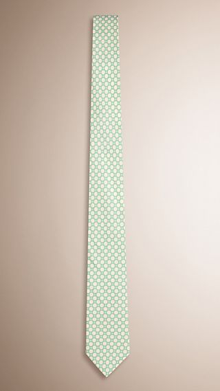 Gravata de seda com corte slim e estampa de poás
