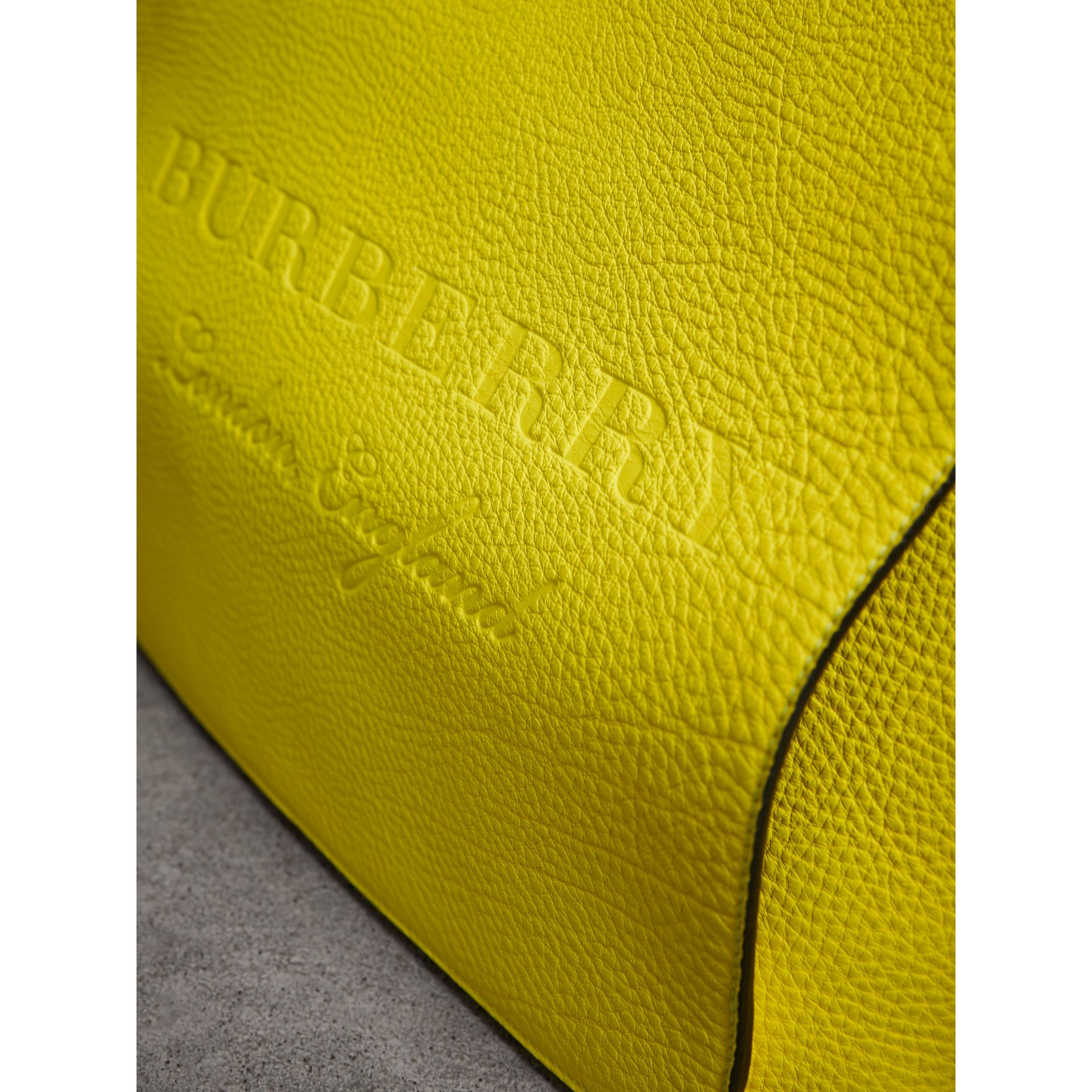 Large Embossed Leather Messenger Bag in Neon Yellow | Burberry - gallery image 1