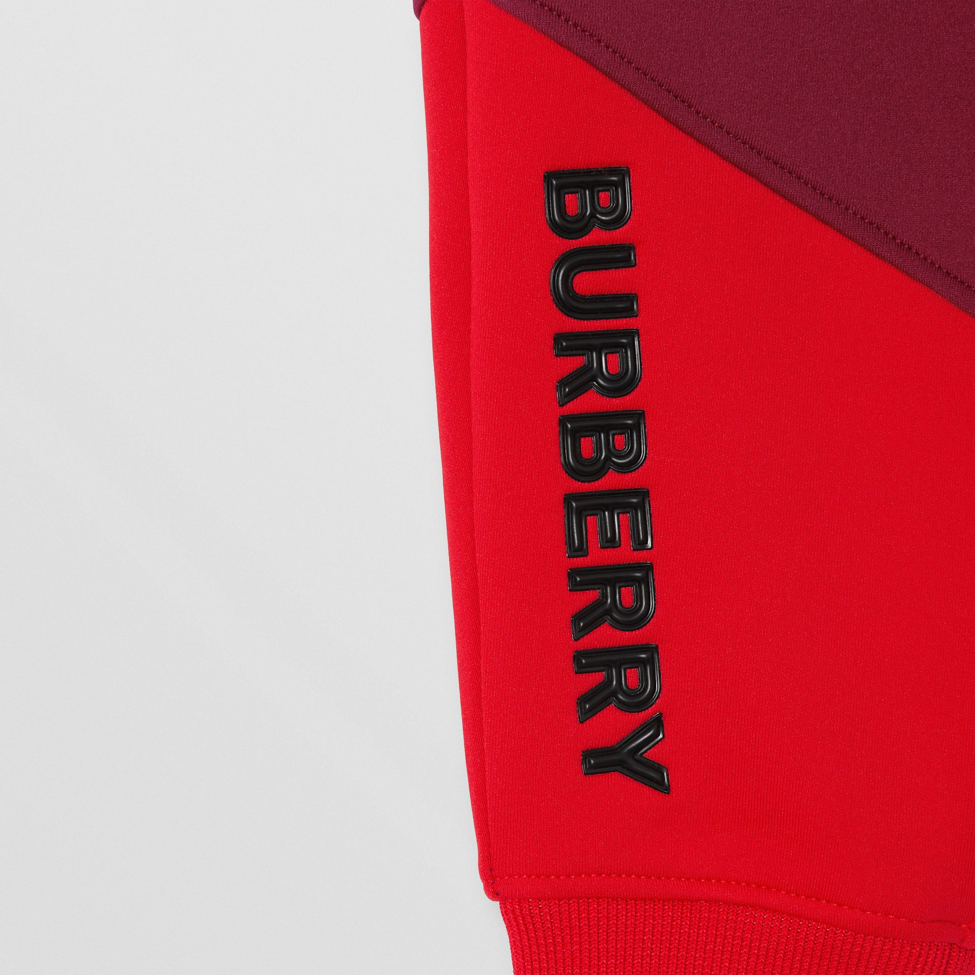 Logo Print Two-tone Stretch Jersey Trackpants in Dark Burgundy - Children | Burberry - gallery image 1