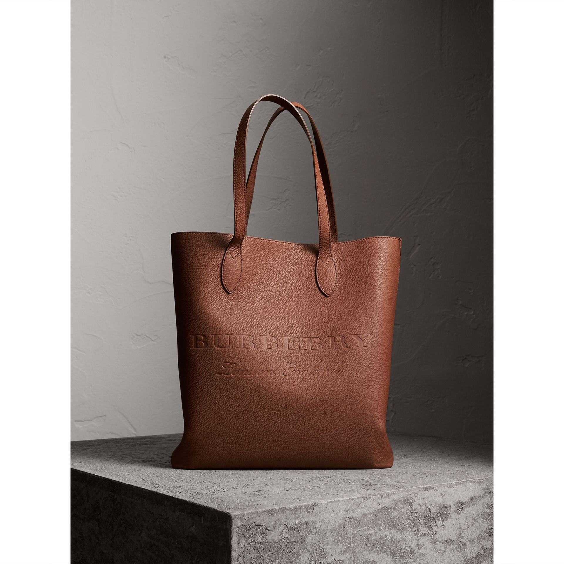 Medium Embossed Leather Tote in Chestnut Brown | Burberry - gallery image 1