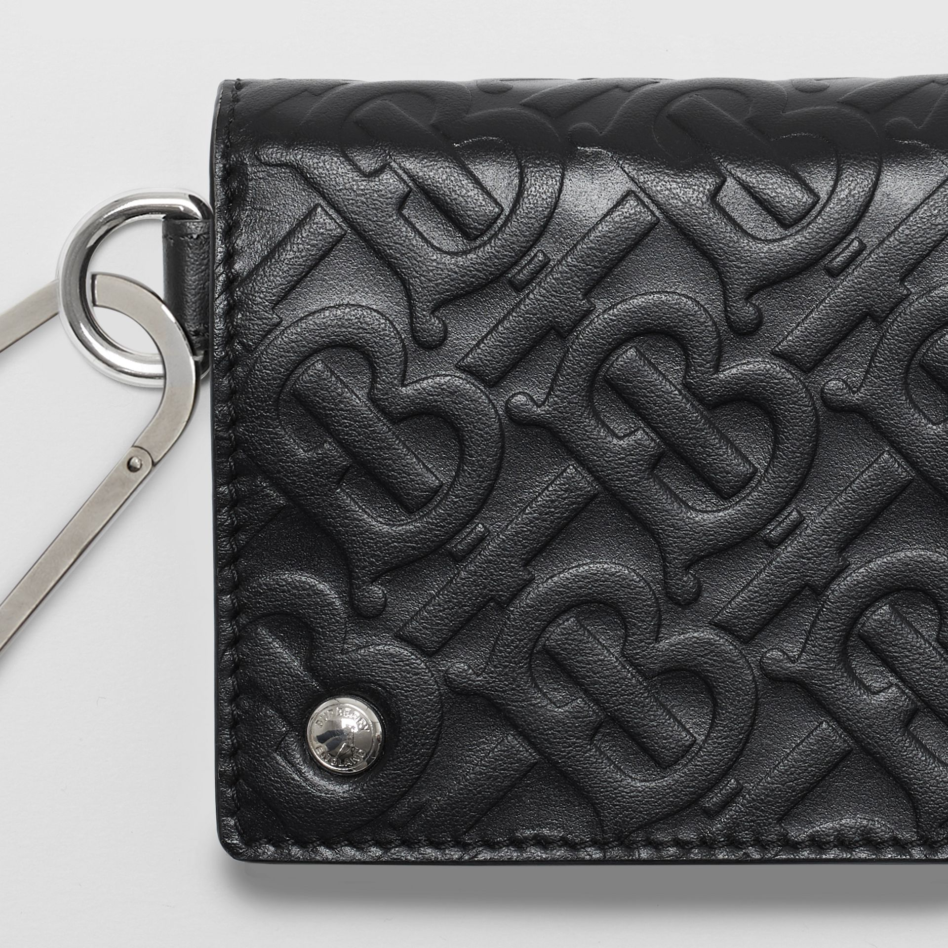 Monogram Embossed Leather Trifold Wallet in Black | Burberry - gallery image 1