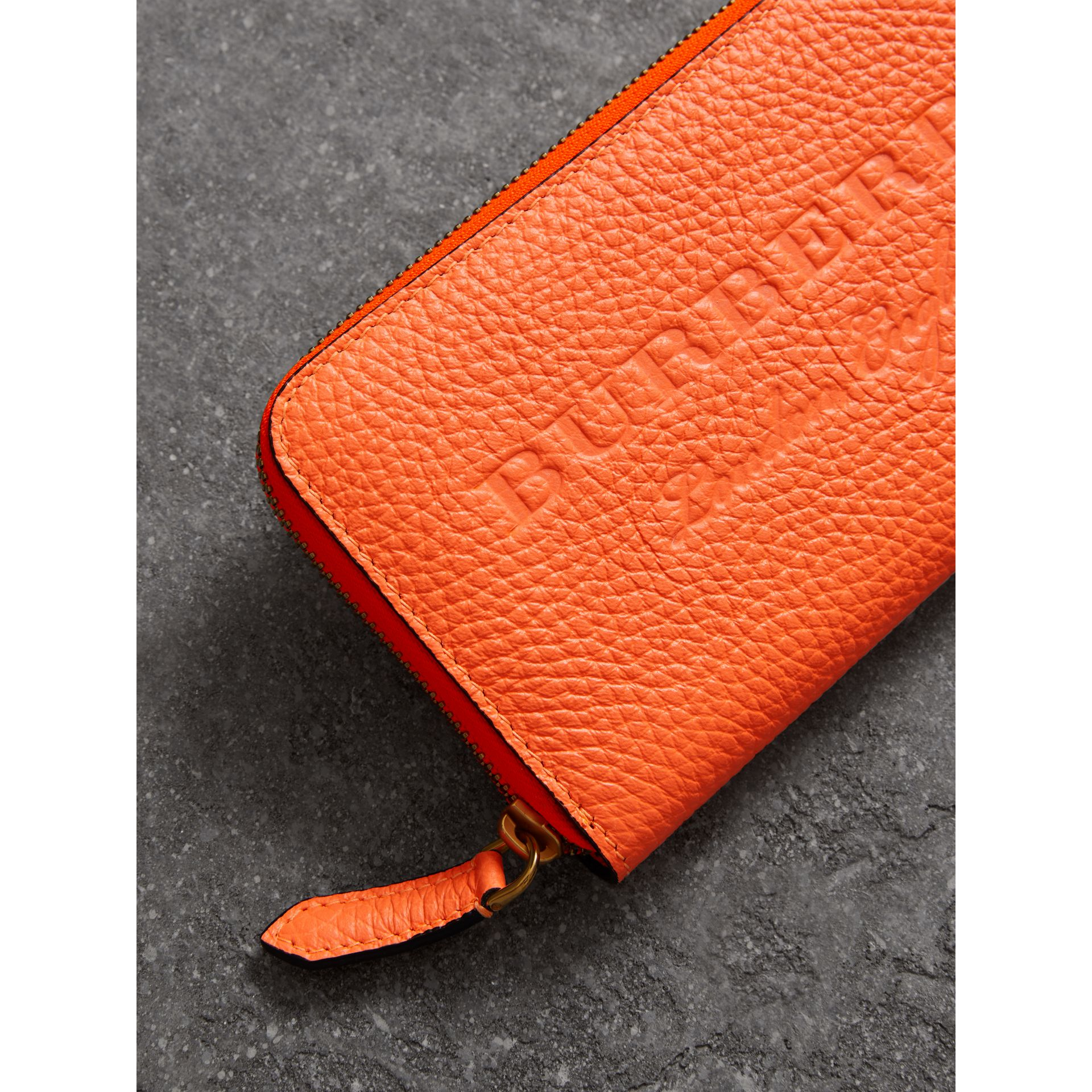 Embossed Leather Ziparound Wallet in Bright Orange - Women | Burberry - gallery image 1