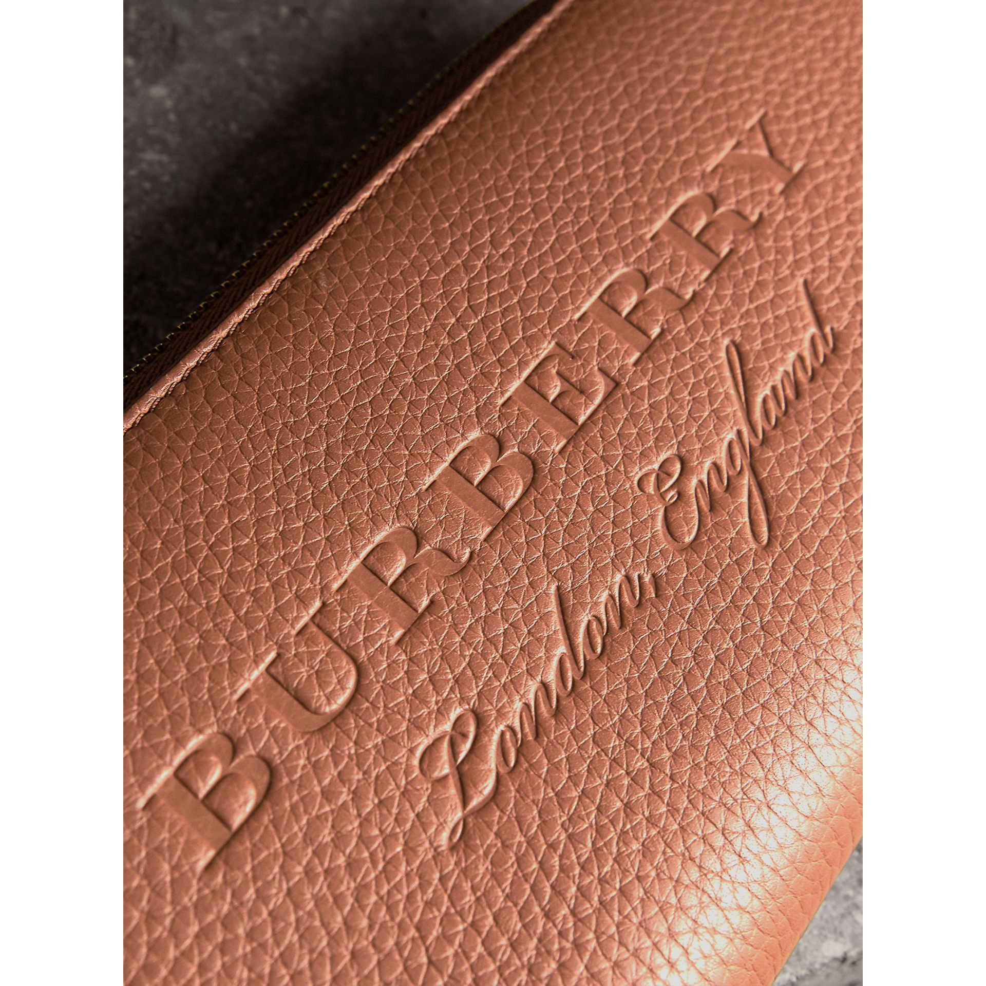 Embossed Grainy Leather Ziparound Wallet in Chestnut Brown - Men | Burberry United Kingdom - gallery image 2