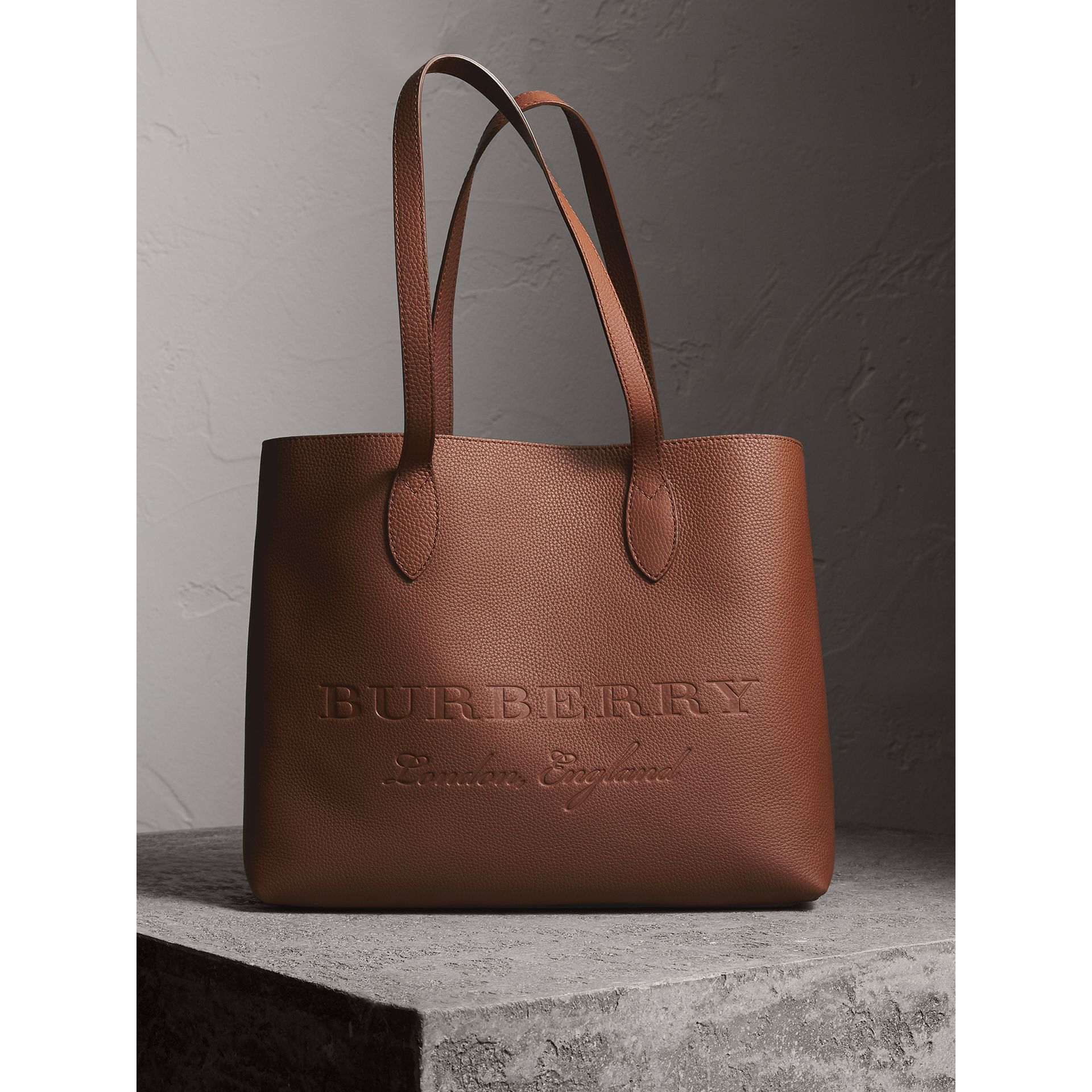 Large Embossed Leather Tote in Chestnut Brown | Burberry - gallery image 1