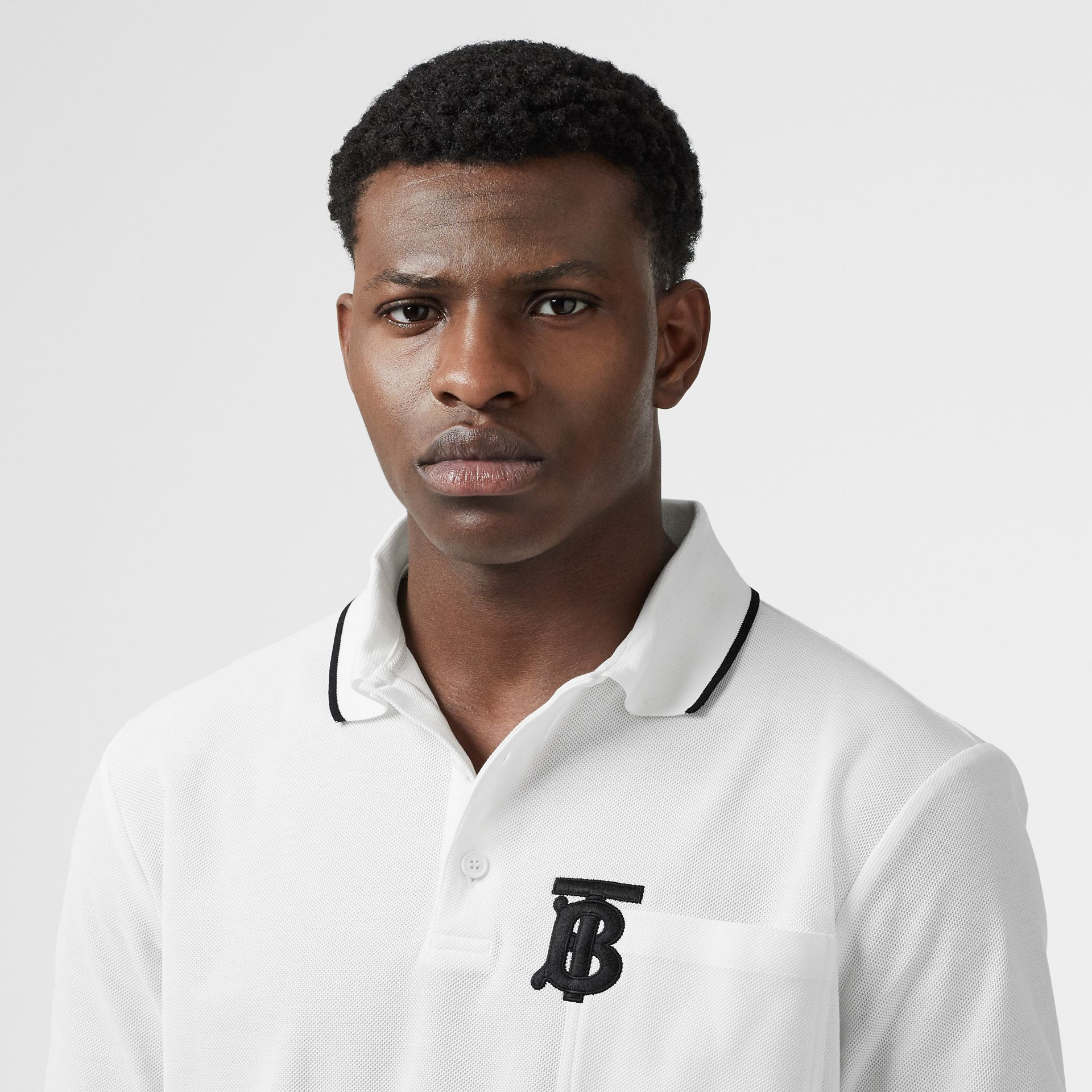 Monogram Motif Tipped Cotton Piqué Polo Shirt in White - Men | Burberry - gallery image 1