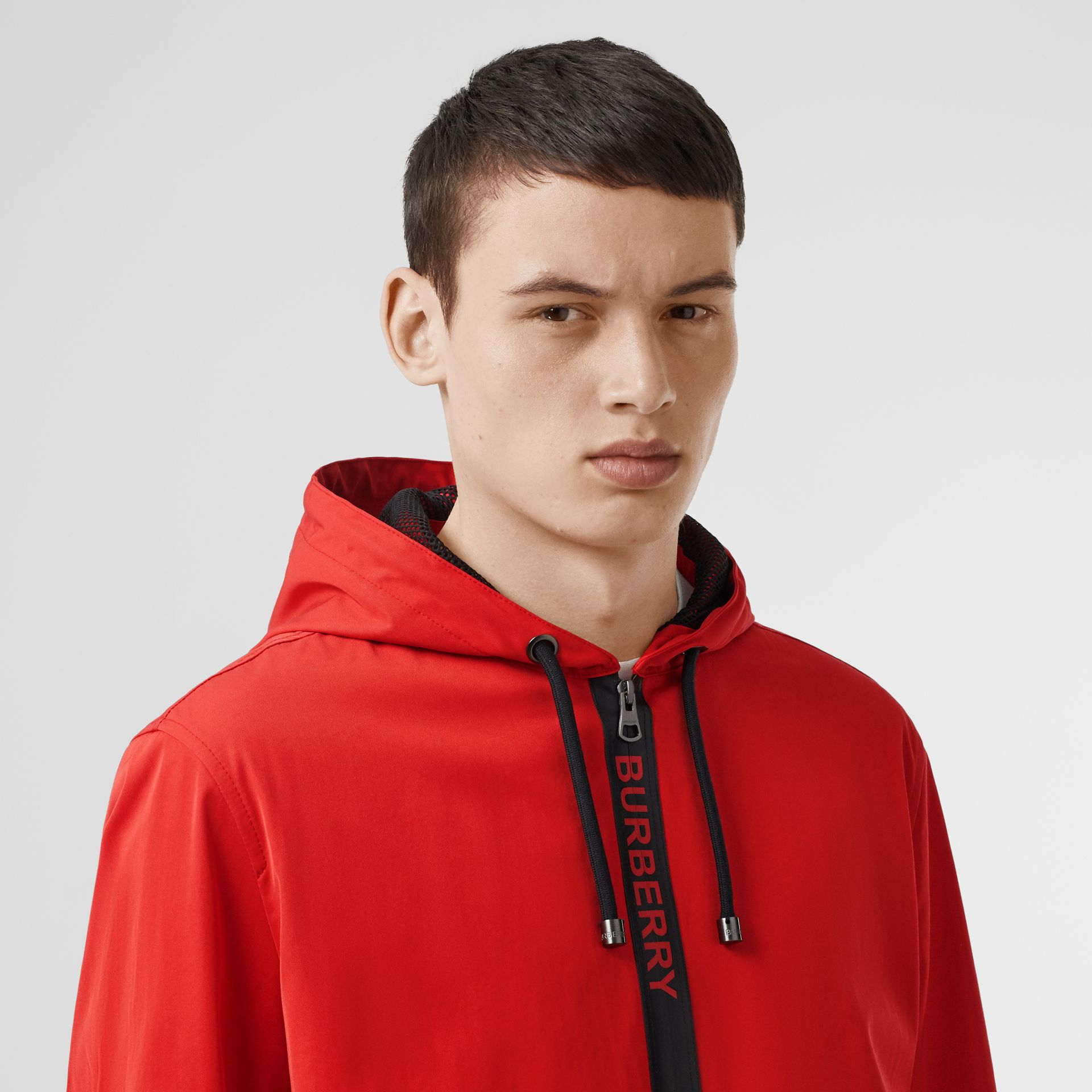 Logo Detail Nylon Cotton Twill Hooded Jacket in Bright Red - Men | Burberry Australia - gallery image 1