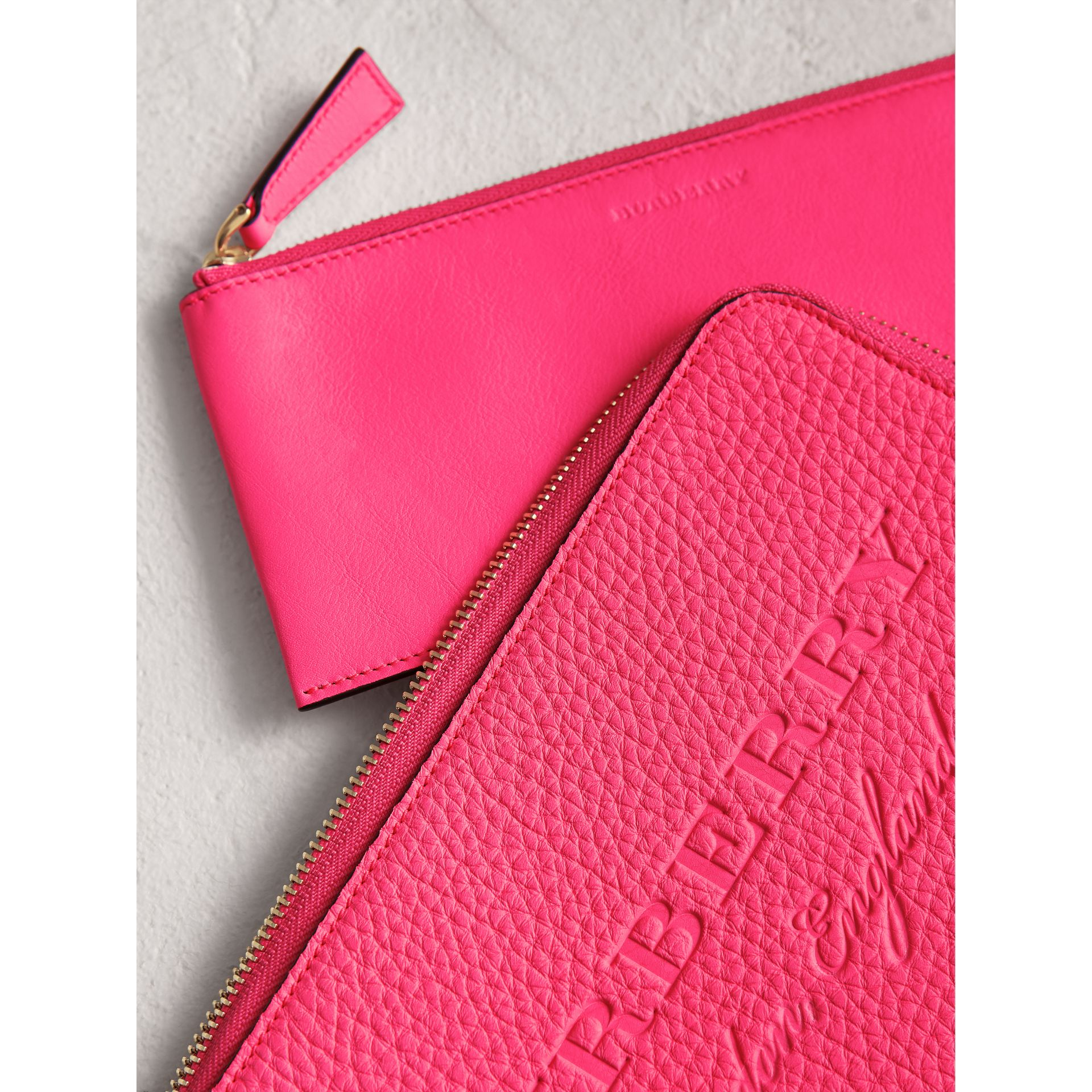 Embossed Neon Leather Travel Wallet in Bright Pink | Burberry - gallery image 1