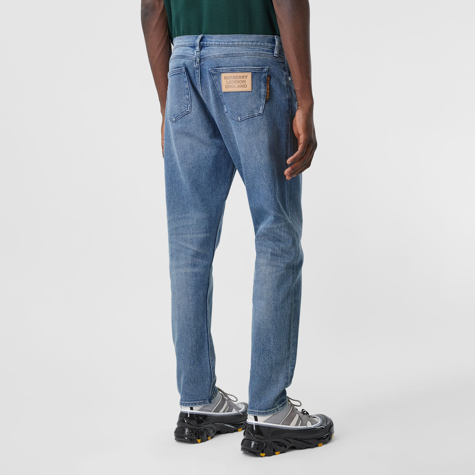 Slim Fit Logo Graphic Washed Jeans in Light Indigo Blue - Men | Burberry - gallery image 2