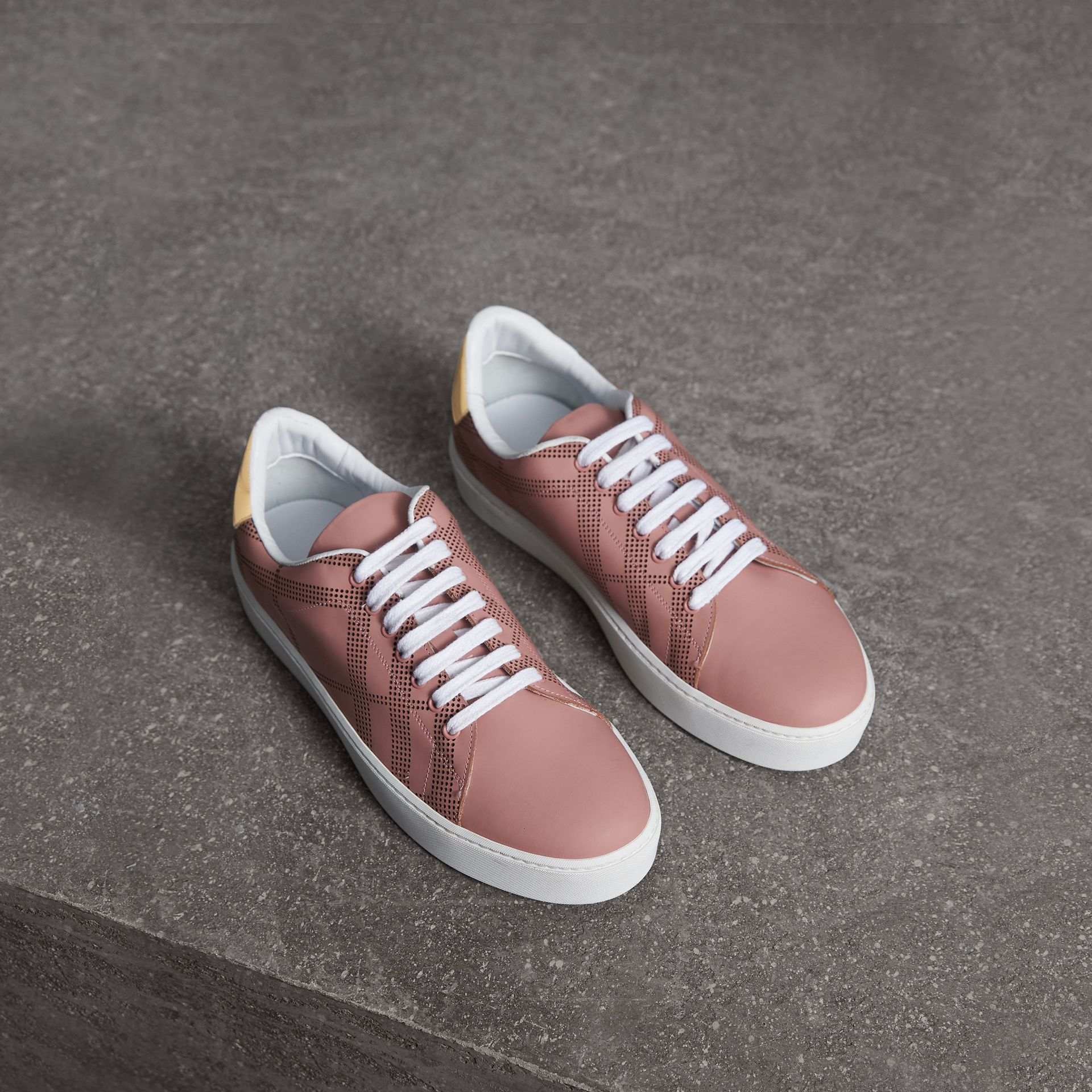 Perforated Check Leather Sneakers in Rose Pink - Women | Burberry - gallery image 0