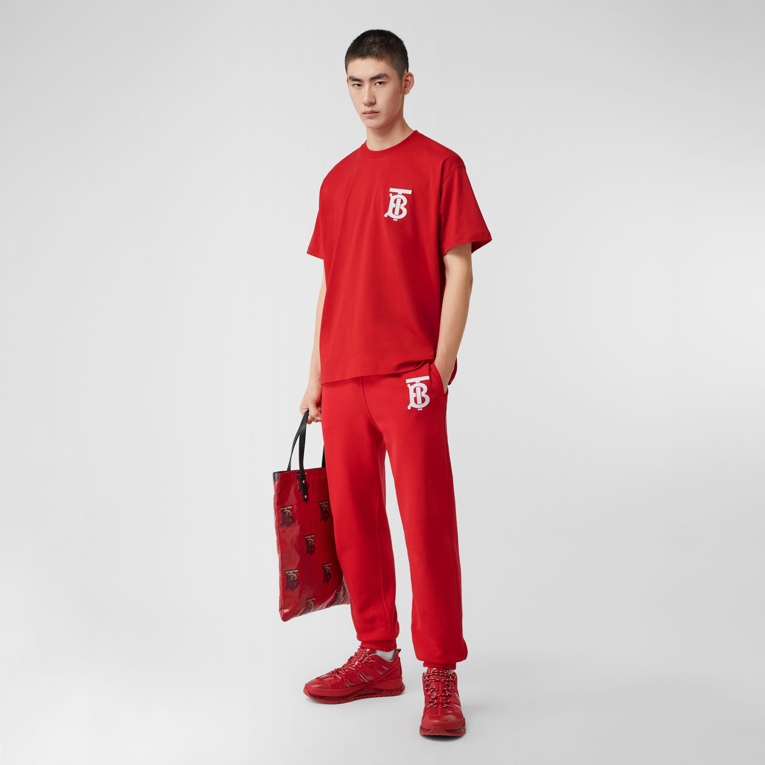Monogram Motif Cotton Jogging Pants in Bright Red - Men | Burberry - 1