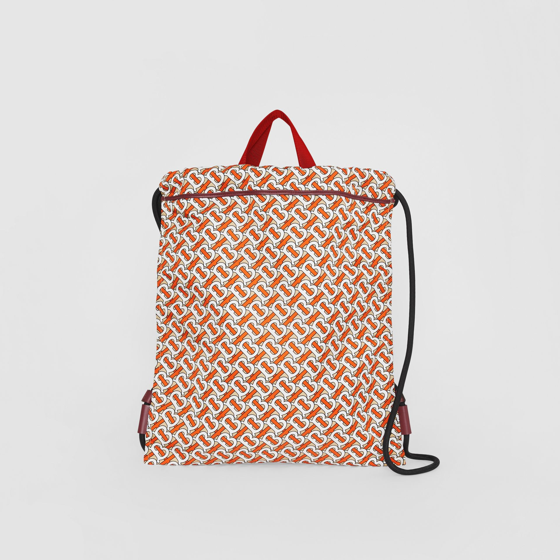 Monogram Print Nylon Drawcord Backpack in Vermilion - Men | Burberry Canada - gallery image 0