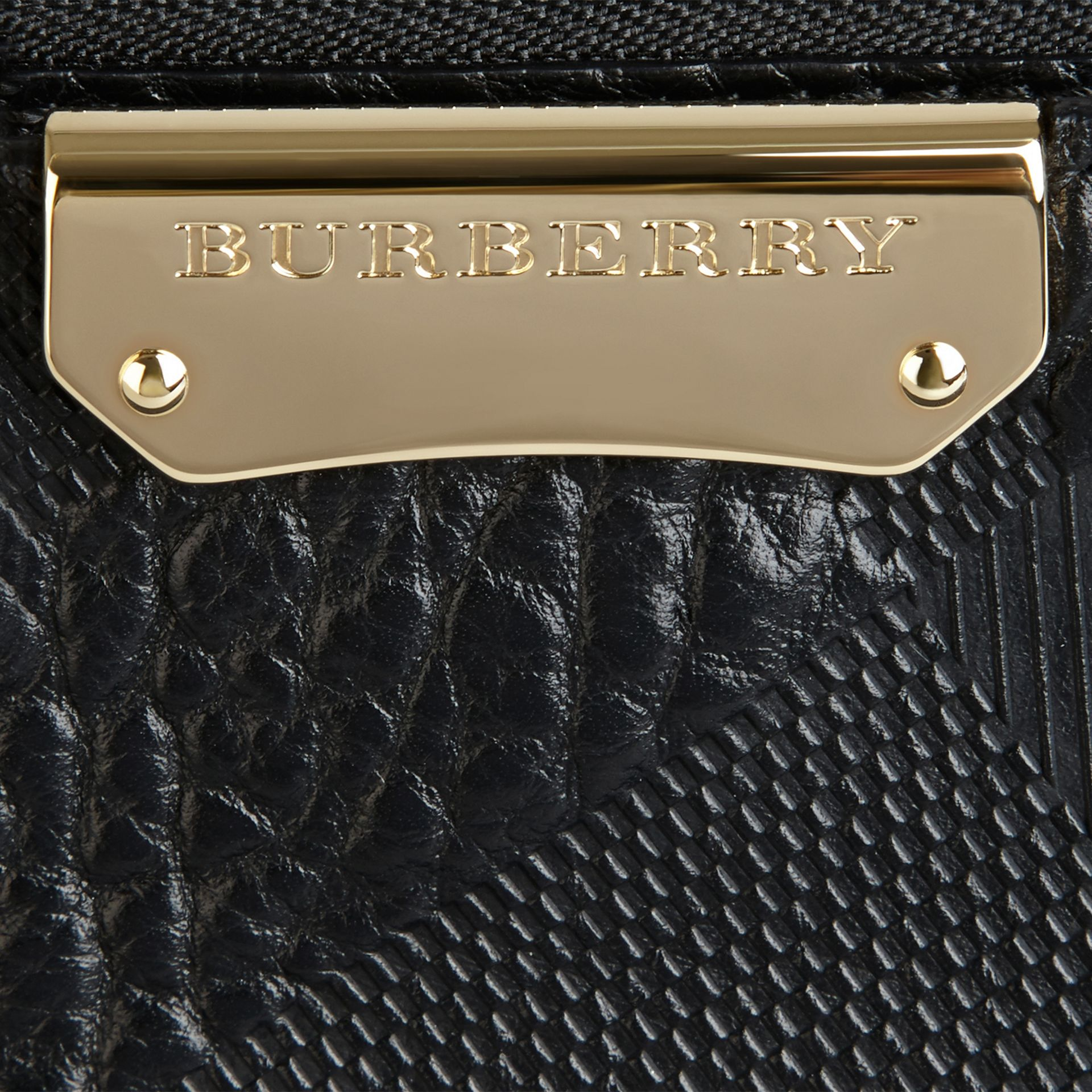 Small Embossed Check Leather Clutch Bag in Black - gallery image 2