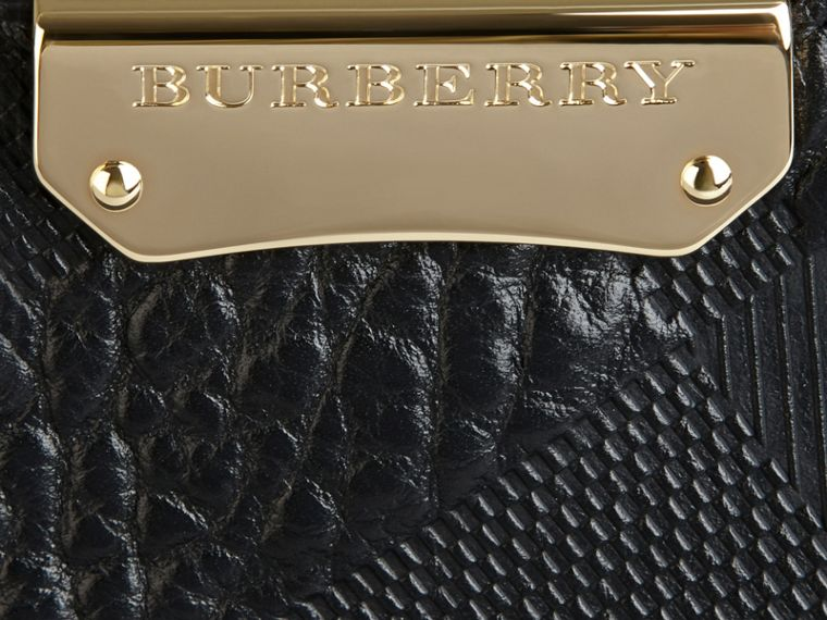 Pochette piccola in pelle con motivo check in rilievo (Nero) - Donna | Burberry - cell image 1