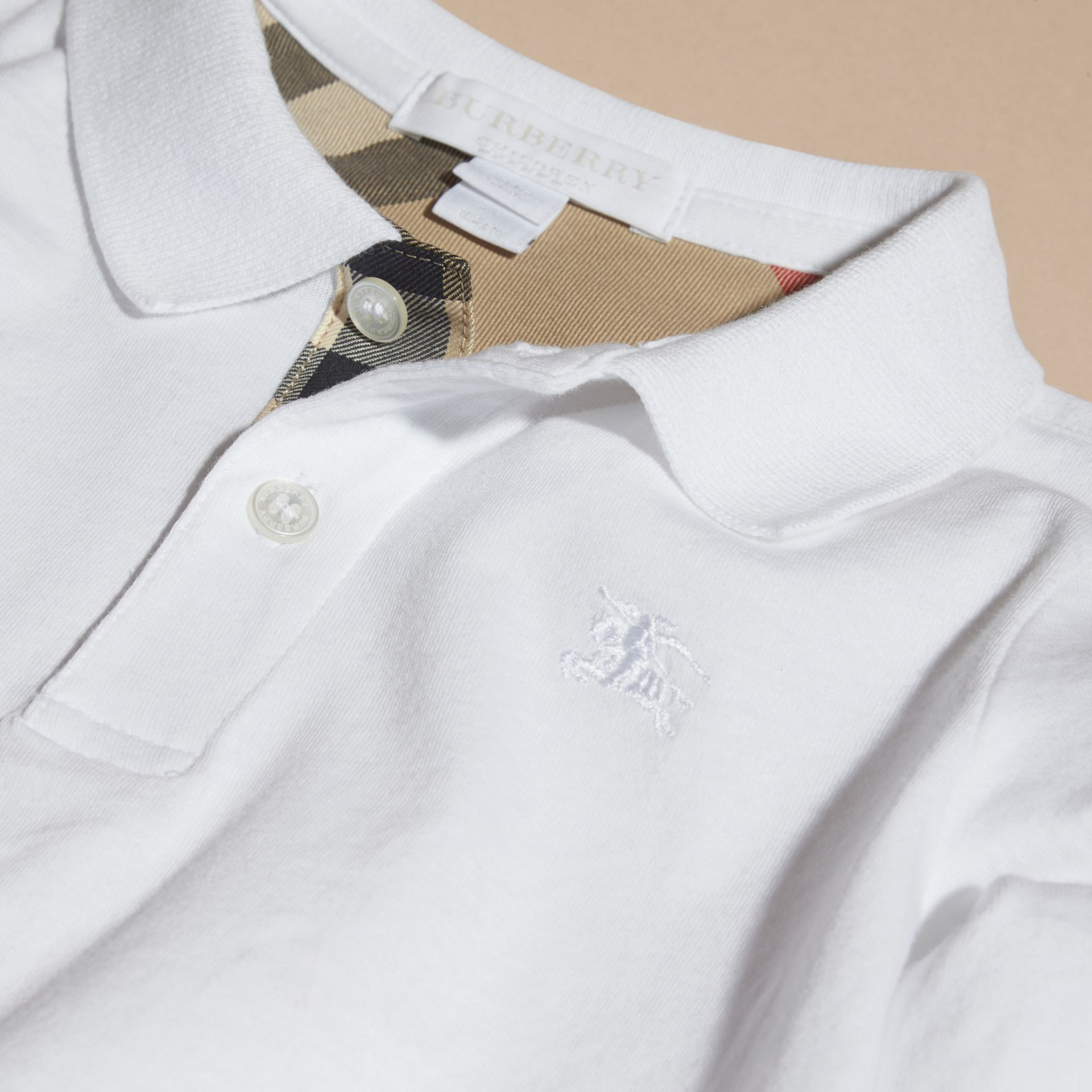 Long-sleeve Cotton Jersey Polo Shirt in White - Boy | Burberry - gallery image 2