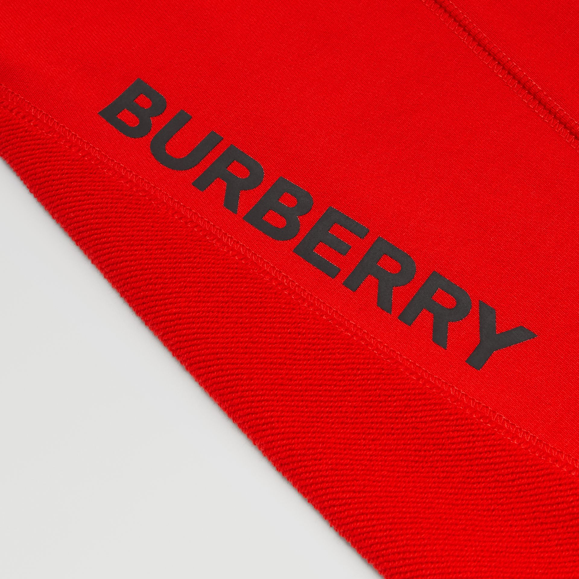 Logo Graphic Cotton Trackpants in Bright Red - Boy | Burberry United States - gallery image 1