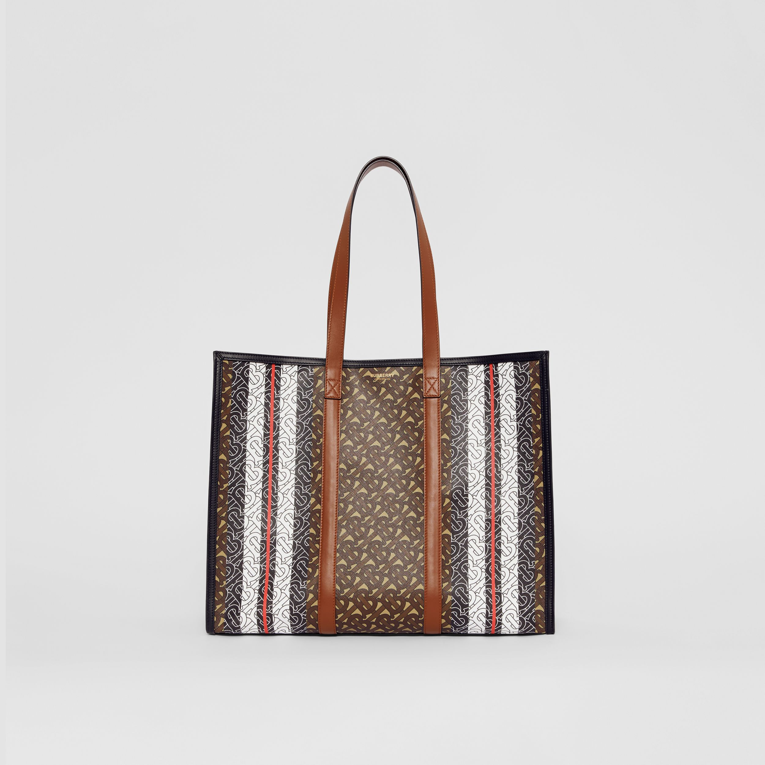 Monogram Stripe E-canvas Tote Bag in Bridle Brown - Women | Burberry - 1