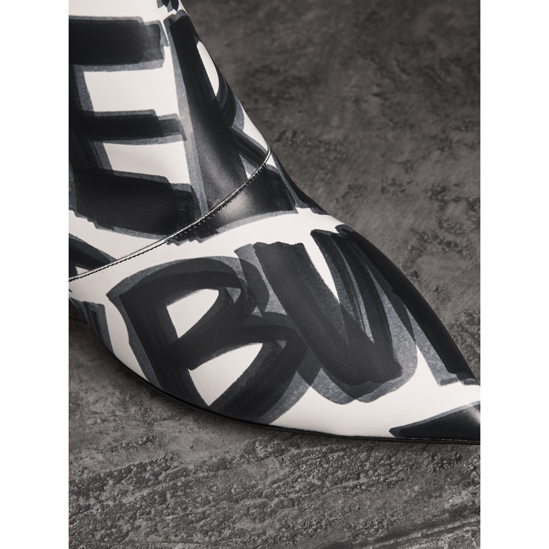 Graffiti Print Leather Ankle Boots in Optic White - Women | Burberry Canada - gallery image 1