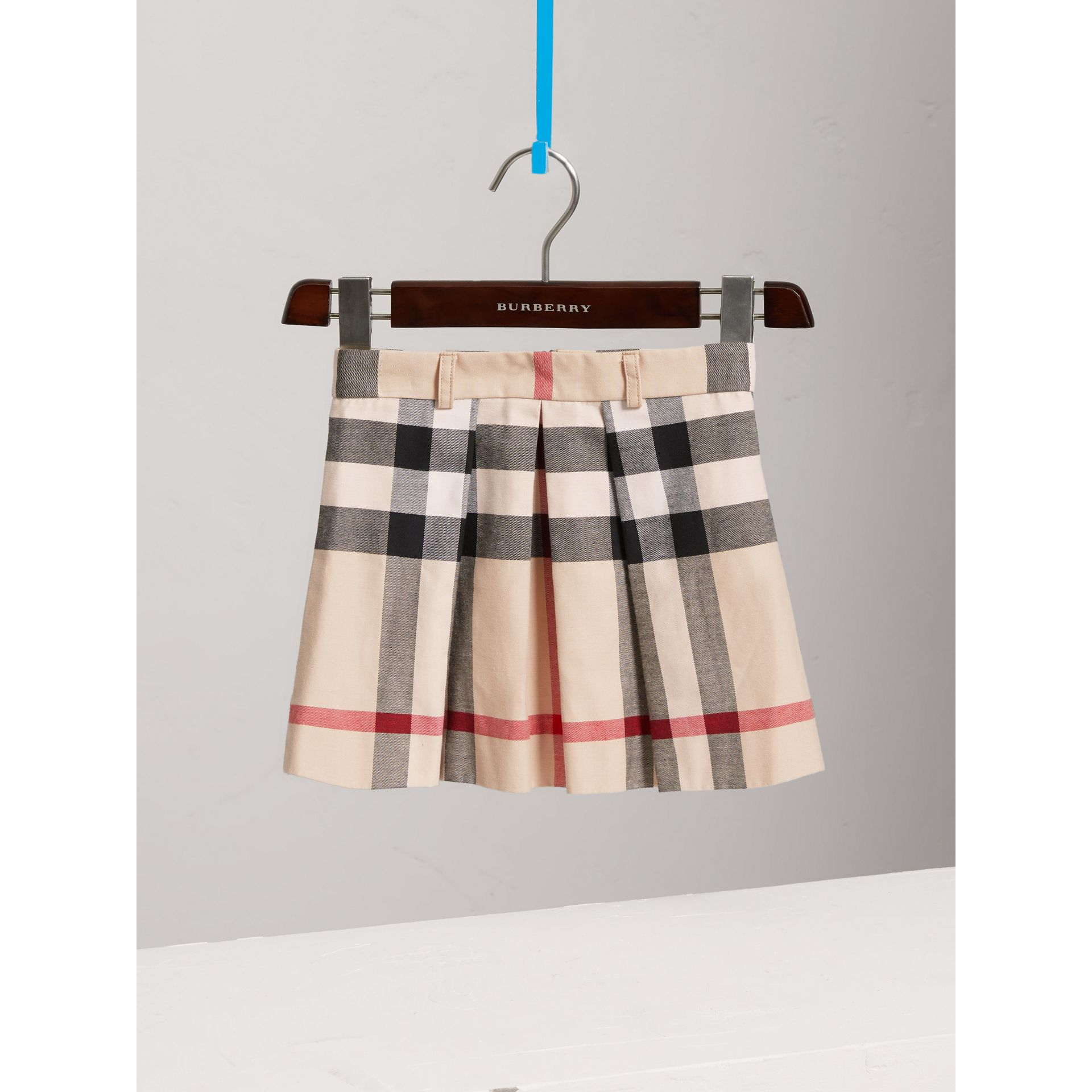 Pleated Check Cotton Skirt in Stone - Girl | Burberry - gallery image 0