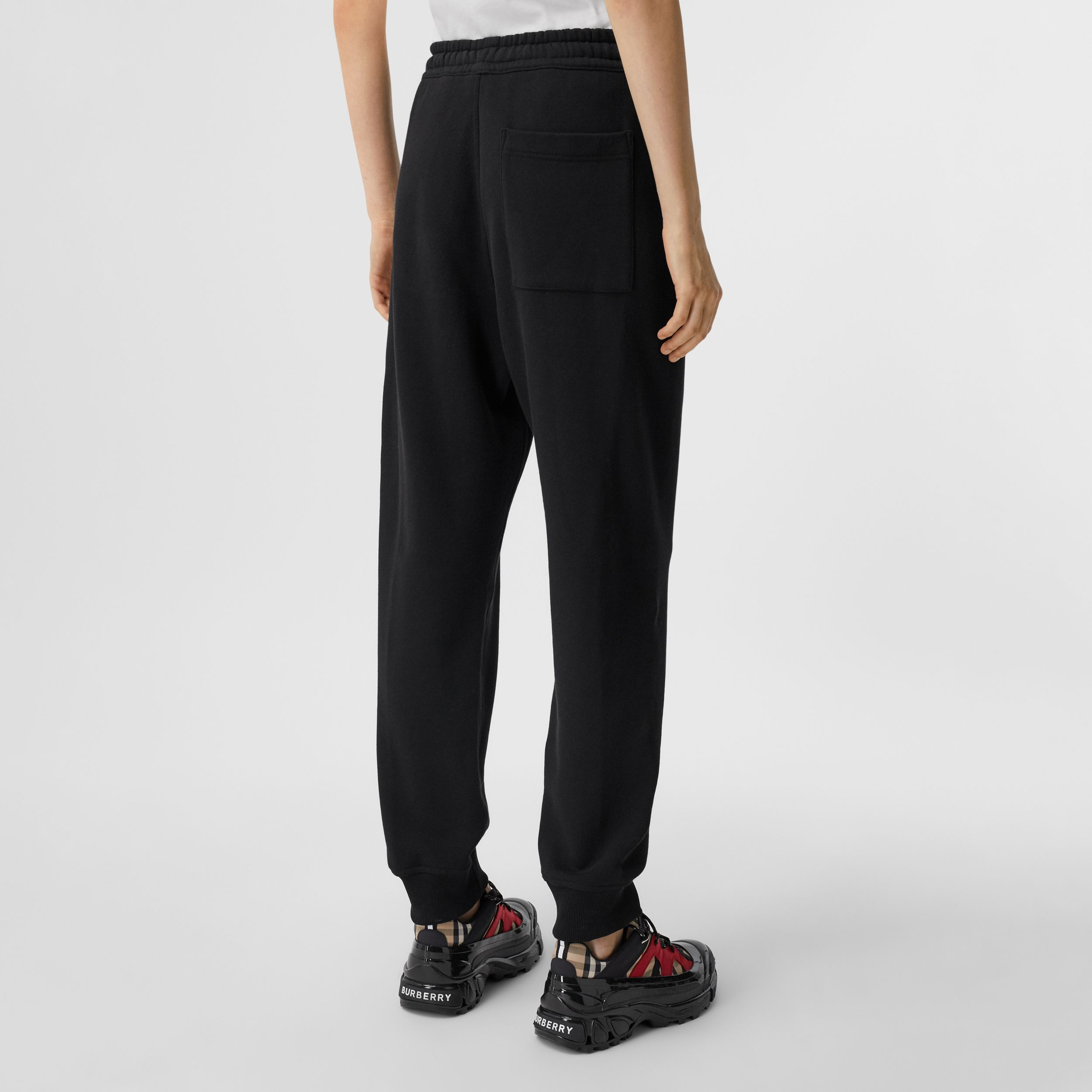 Logo Print Cotton Jogging Pants in Black - Women | Burberry - 3
