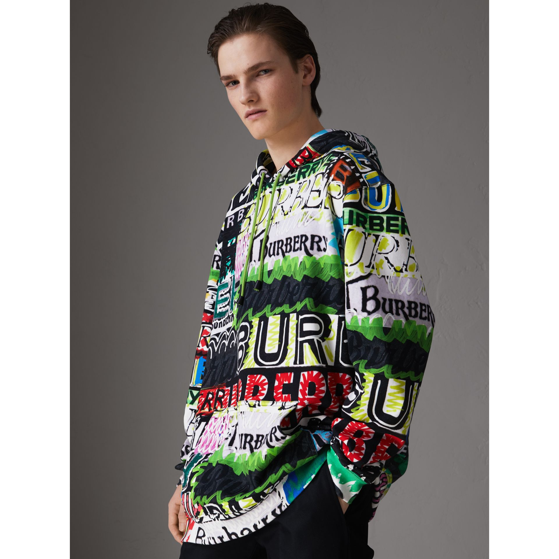Oversized Logo Print Cotton Hoodie in Bright Green - Men | Burberry Australia - gallery image 0