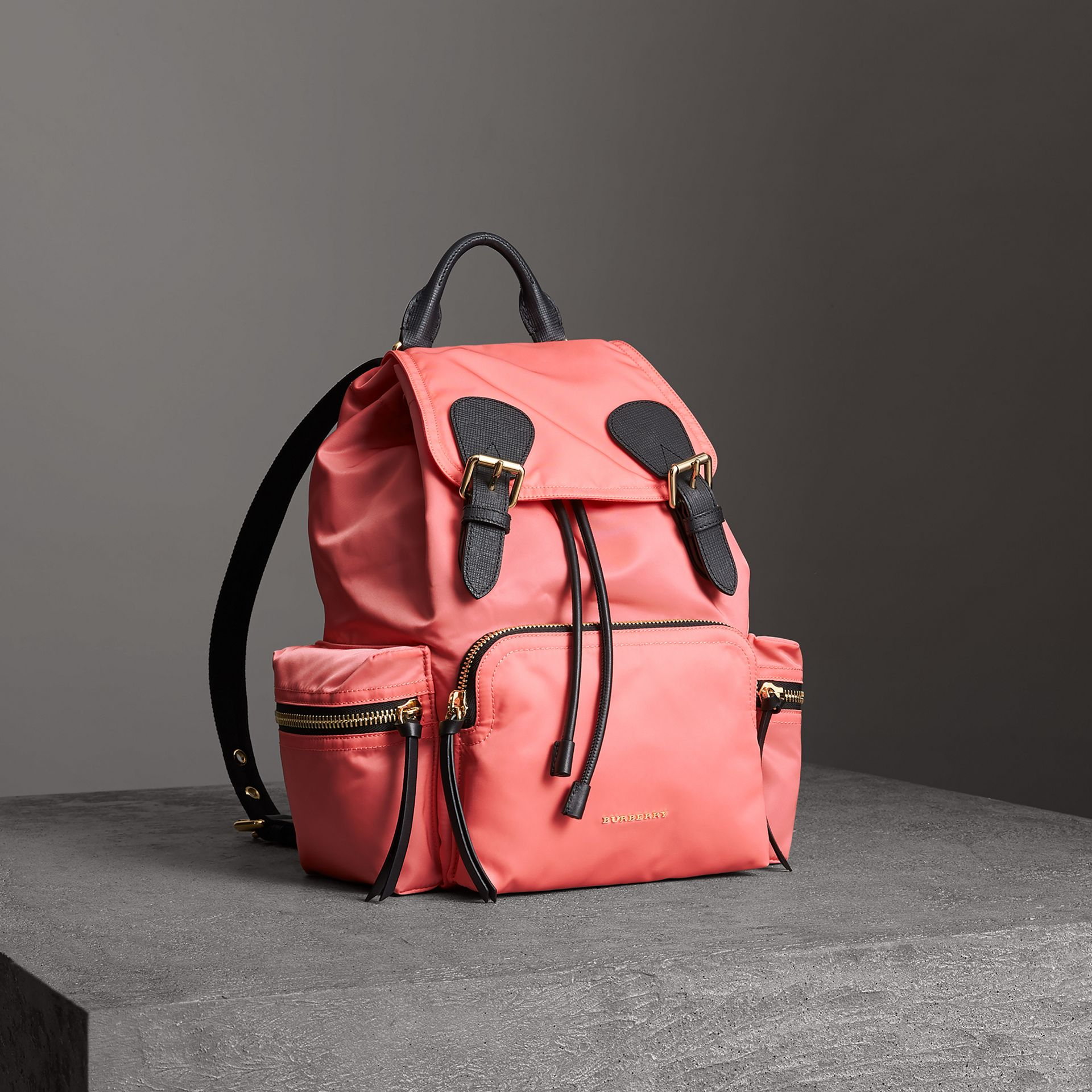 The Medium Rucksack in Technical Nylon and Leather in Bright Coral Pink - Women | Burberry United Kingdom - gallery image 0