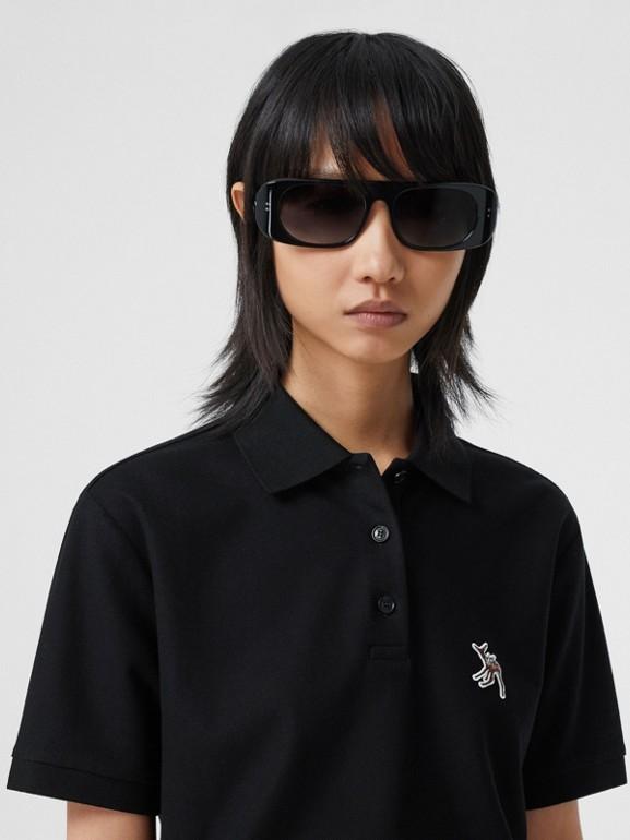 Deer Motif Cotton Piqué Oversized Polo Shirt in Black - Women | Burberry - cell image 1