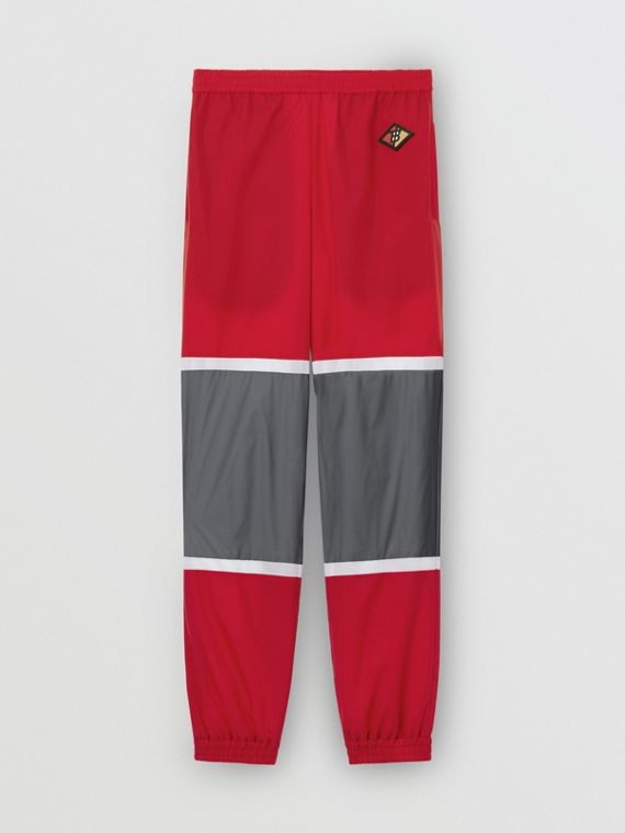 Logo Graphic Striped Nylon Trackpants in Bright Red