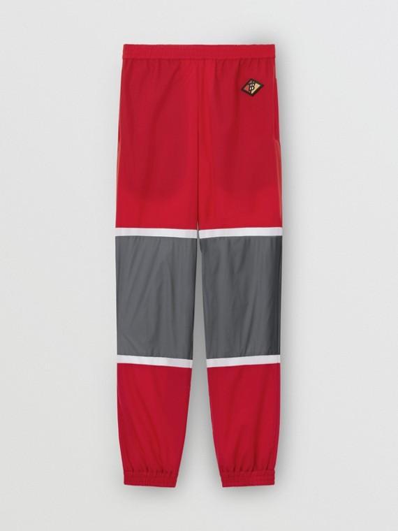 Track pants de nylon listrado com logotipo gráfico (Vermelho Intenso)