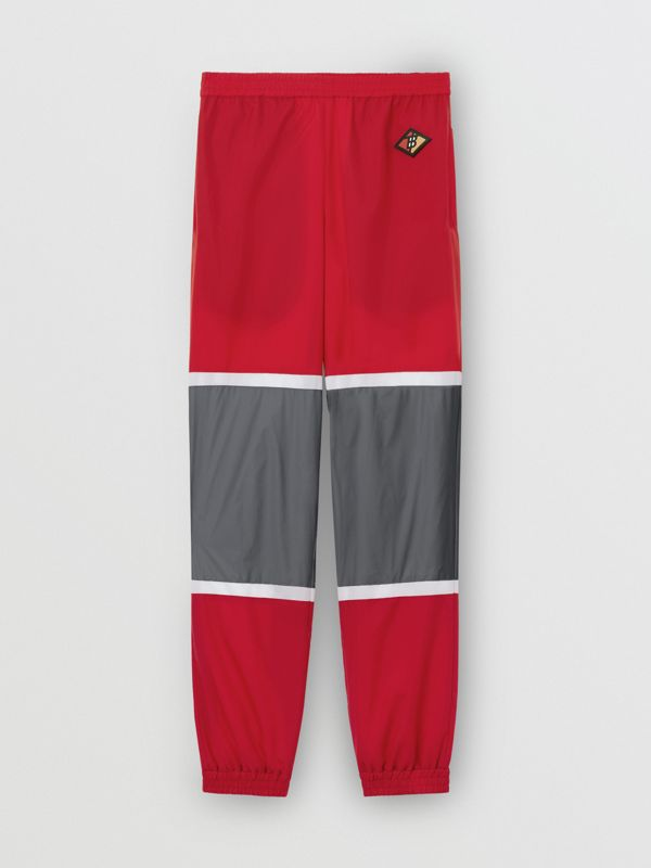 Logo Graphic Striped Nylon Trackpants in Bright Red - Men | Burberry - cell image 3