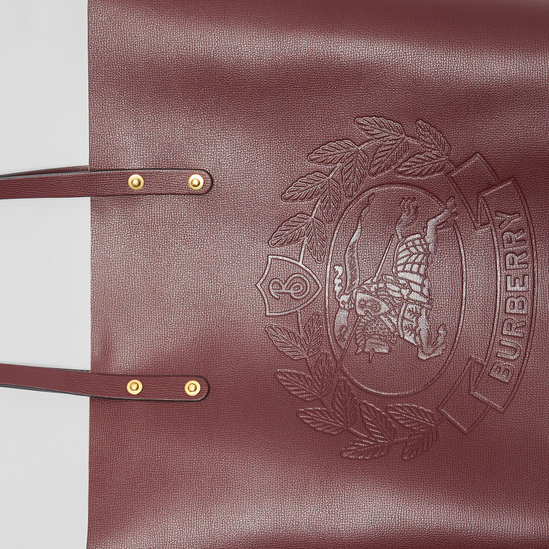 Large Embossed Crest Leather Tote in Burgundy | Burberry Canada - gallery image 1
